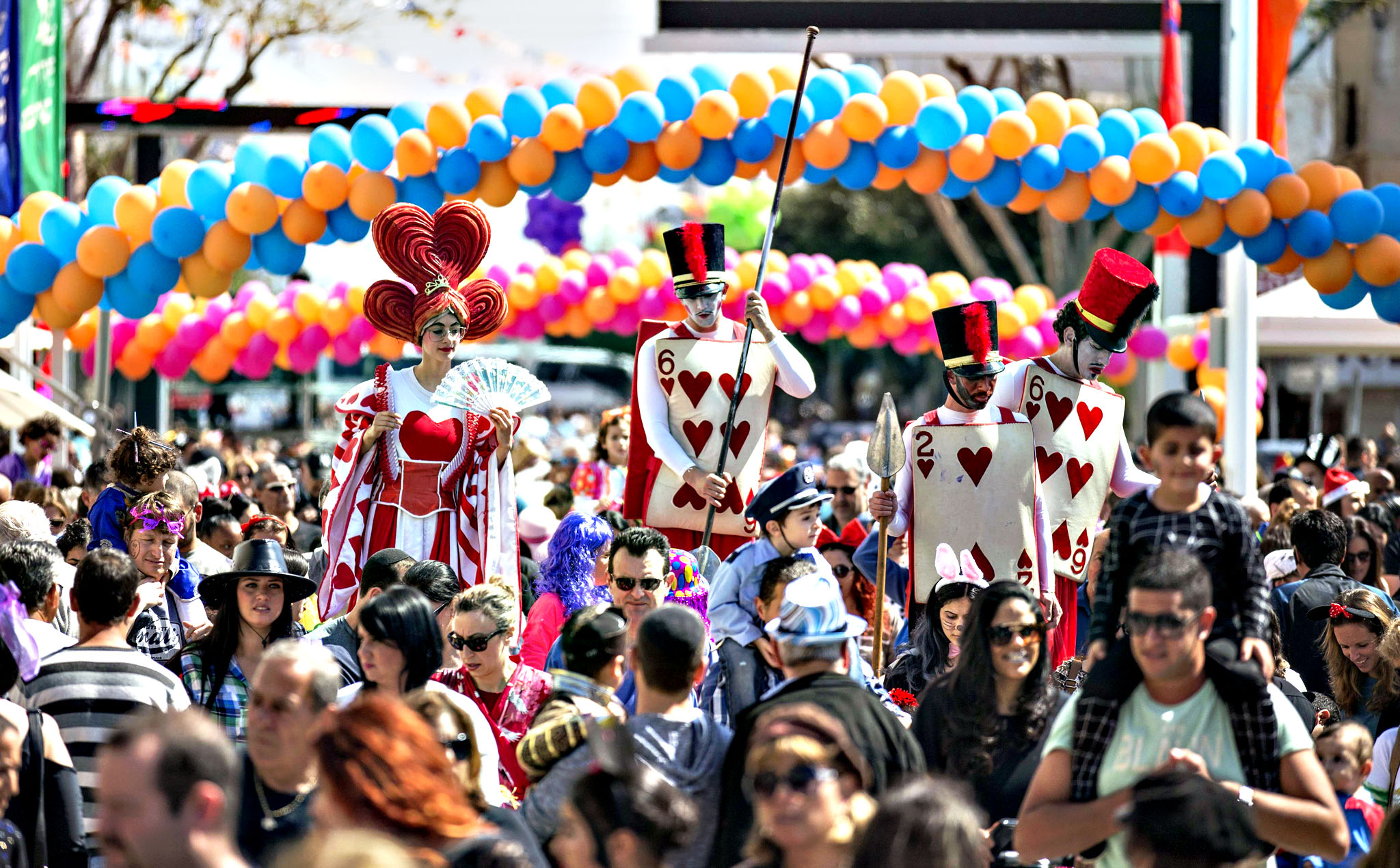 Dressed up Israelis take part in a parade during the festivities of the Jewish Purim festival on March 5, 2015 in the central Israeli city of Netanya. The carnival-like Purim holiday is celebrated with parades and costume parties to commemorate the deliverance of the Jewish people from a plot to exterminate them in the ancient Persian empire 2,500 years ago, as recorded in the Biblical Book of Esther.