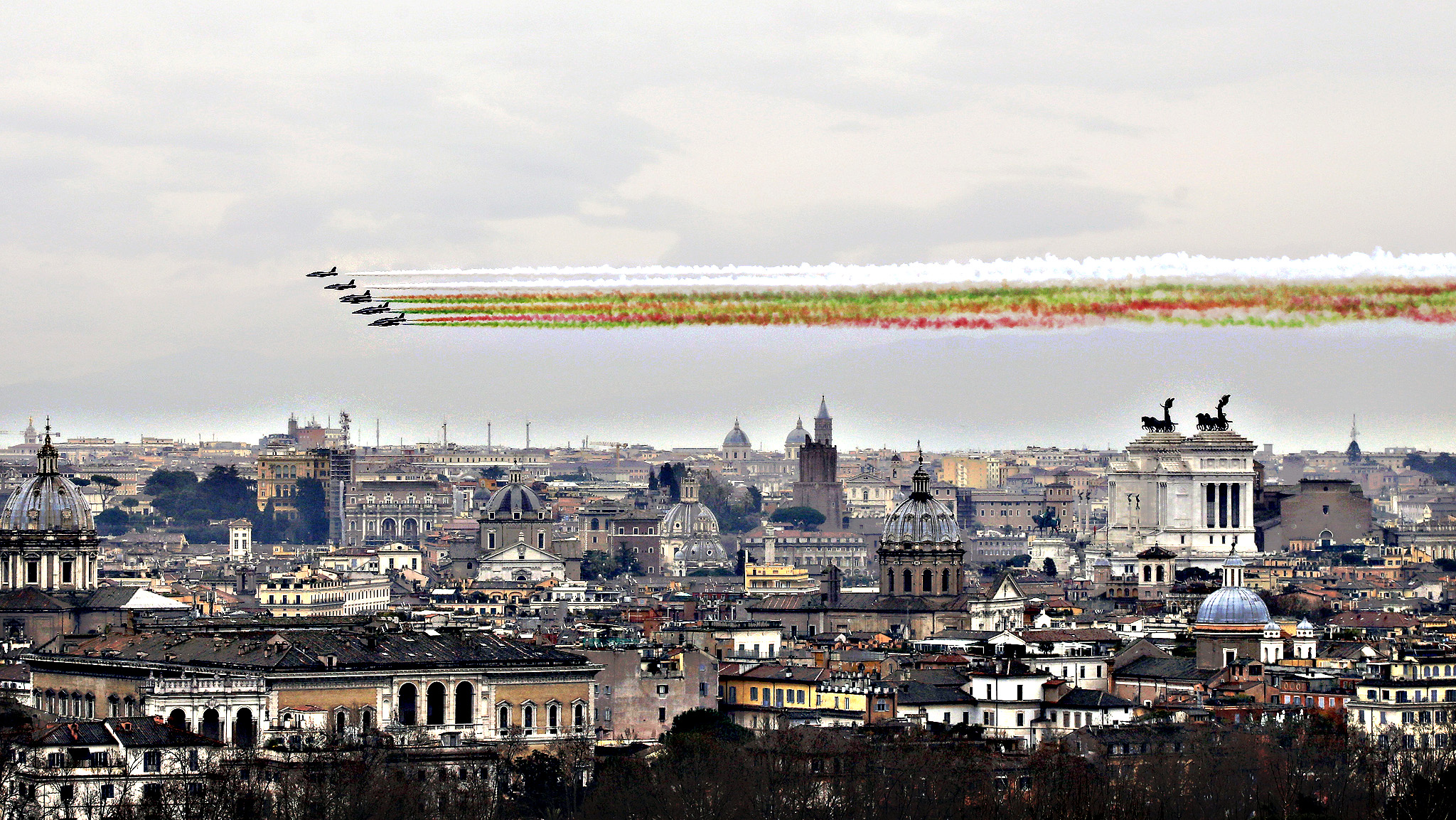 The 'Frecce Tricolori' Italian Air Force acrobatic squad fly over Rome, Tuesday, March 17, 2015 to mark the 154th anniversary of the Italian Unification in 1861