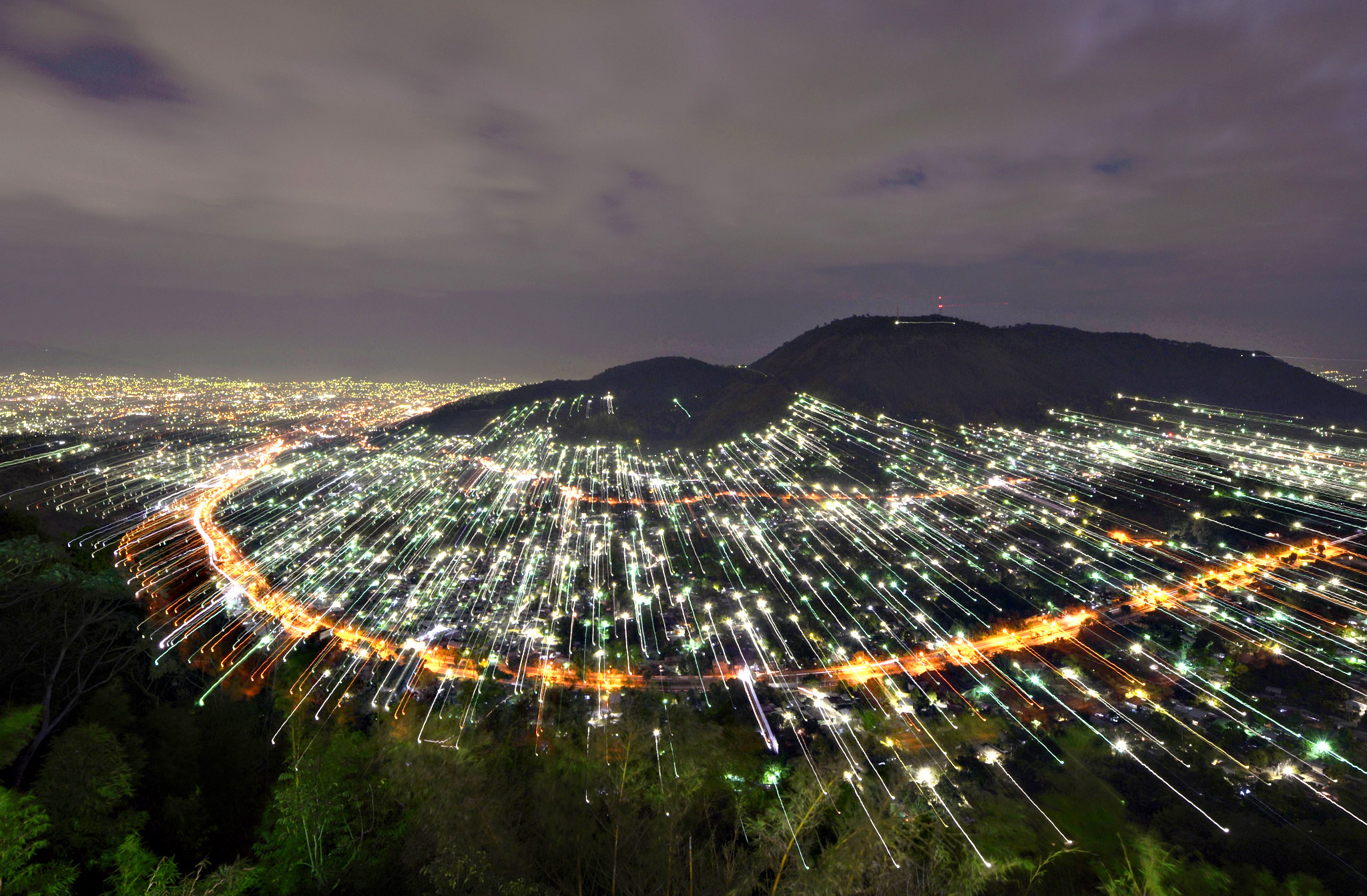 Night view of San Salvador, El Salvador, using camera zoom effect