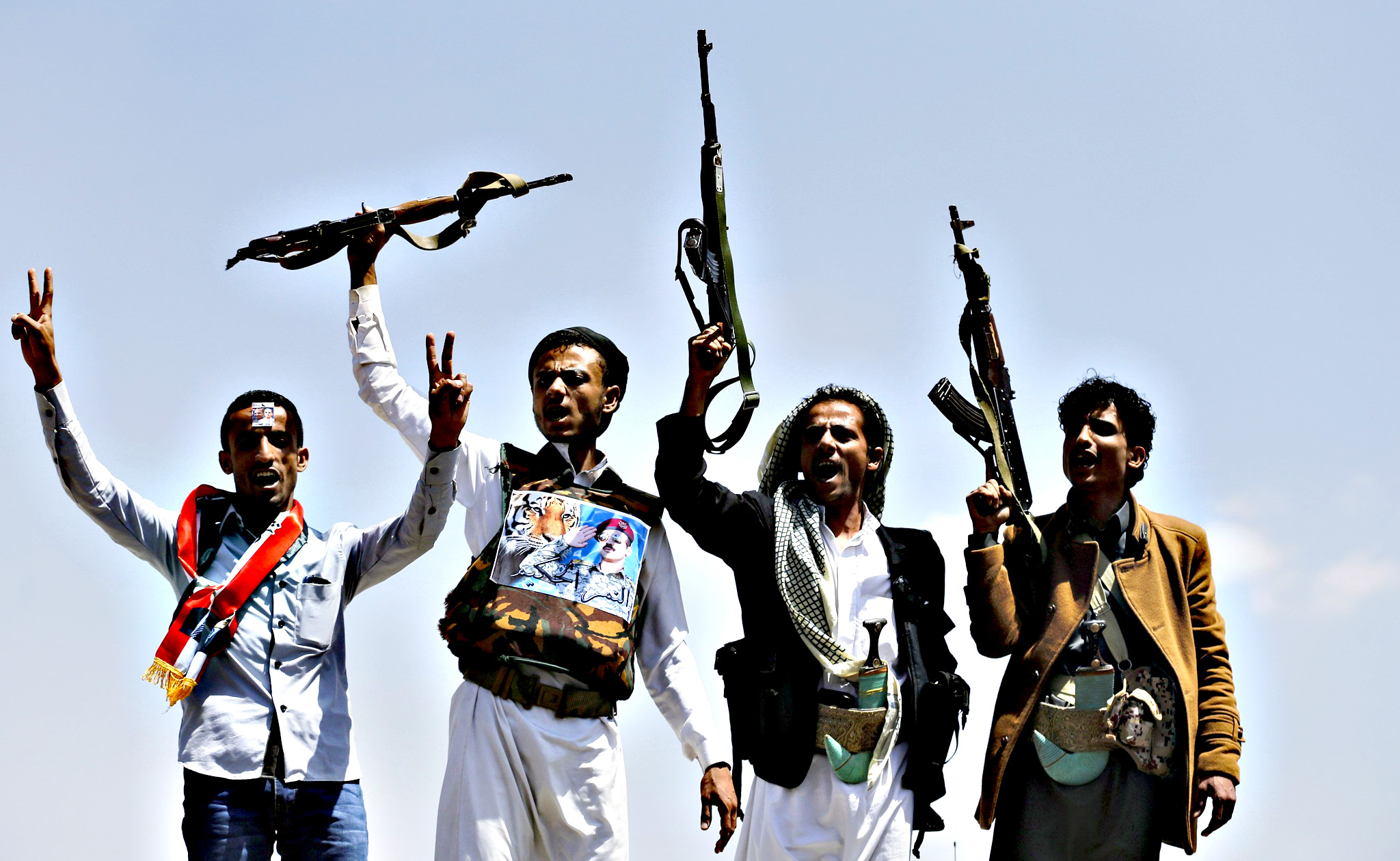 Supporters of Ahmed Ali Abdullah Saleh, the son of Yemen's former President Ali Abdullah Saleh, raise their rifles as they demonstrate in Sanaa, March 10, 2015. The supporters were demanding for presidential elections to be held and for Ahmed Ali Abdullah Saleh to run for presidency.