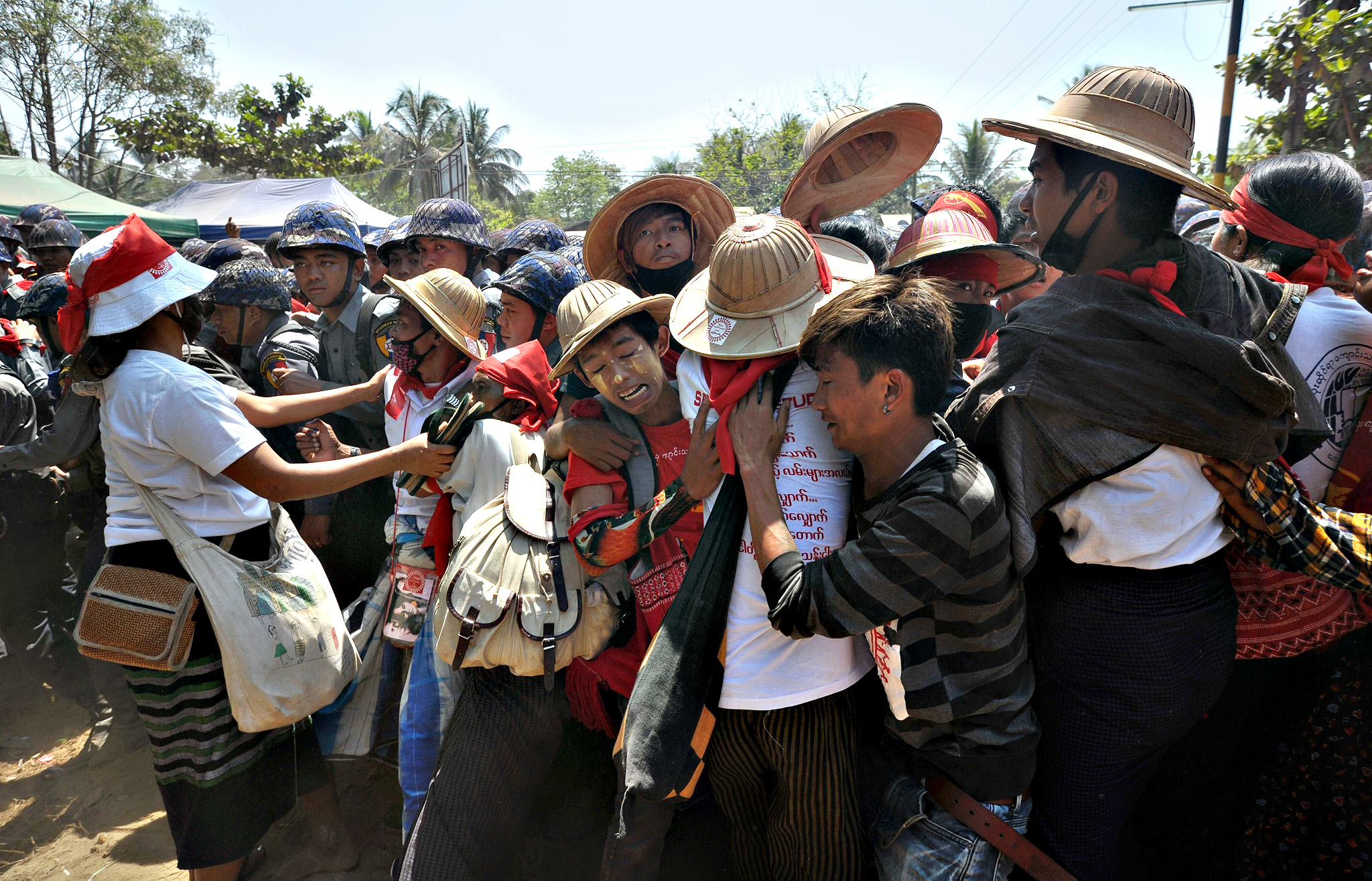 Myanmar student protesters and nationalists clash with riot police during a march in Letpadan town, some 130 kilometres (80 miles) north of Myanmar's main city on March 10, 2015. Student protesters have embarked on months of demonstrations calling for education reform, but plans by a core group to march to Yangon have been halted by police in the dusty central town of Letpadan, who have surrounded around 150 activists since March 2.