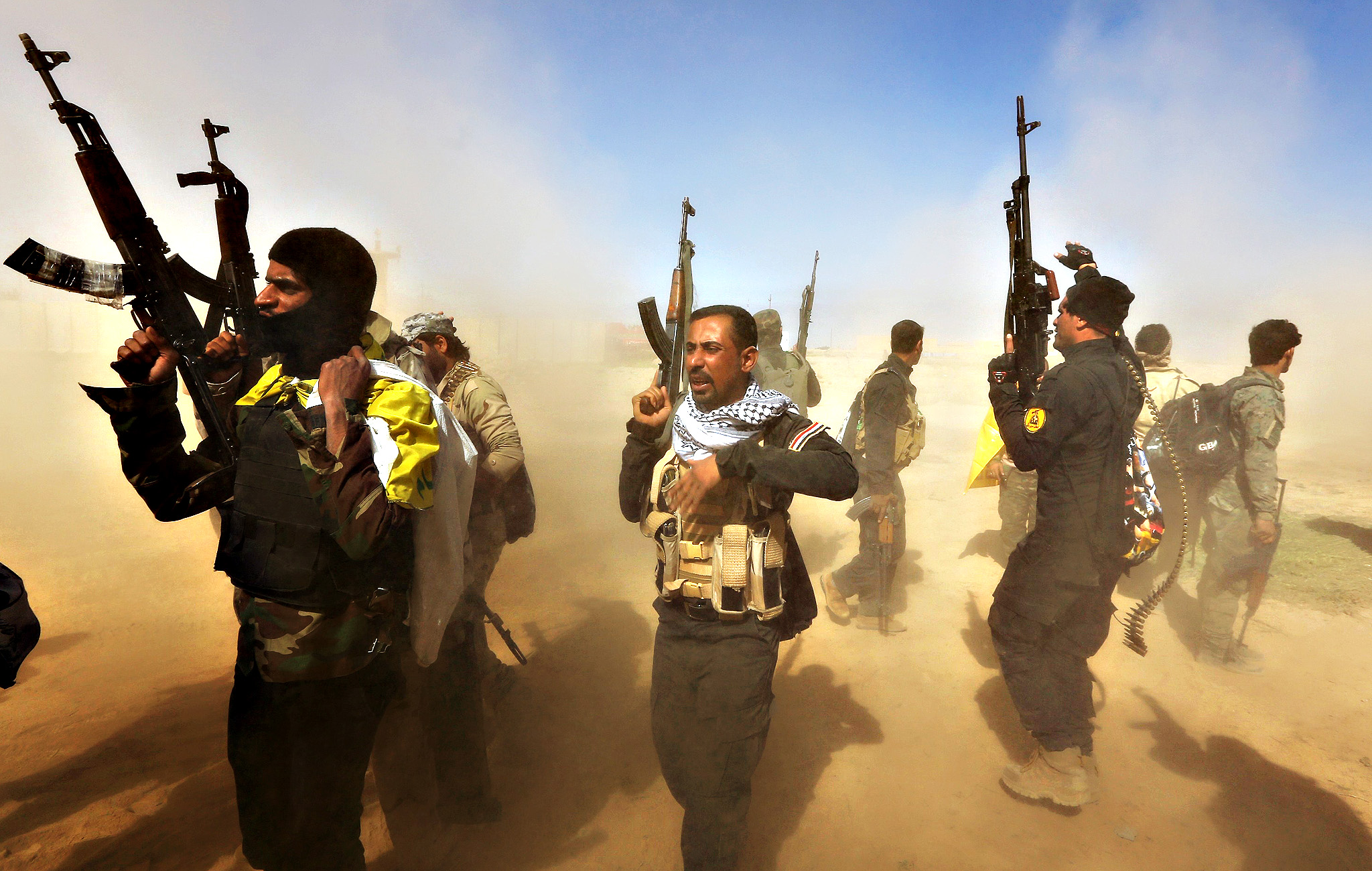 Iraqi fighters of the government-controlled Popular Mobilisation units take part in a military operation to take control of Tikrit, 160 kms north of Baghdad,  from jihadists from the Islamic state (IS) group, on March 11 2015.  The city, which is the home town of former president Saddam Hussein, is the toughest target for the government troops and allied militias that started winning back lost ground last year.