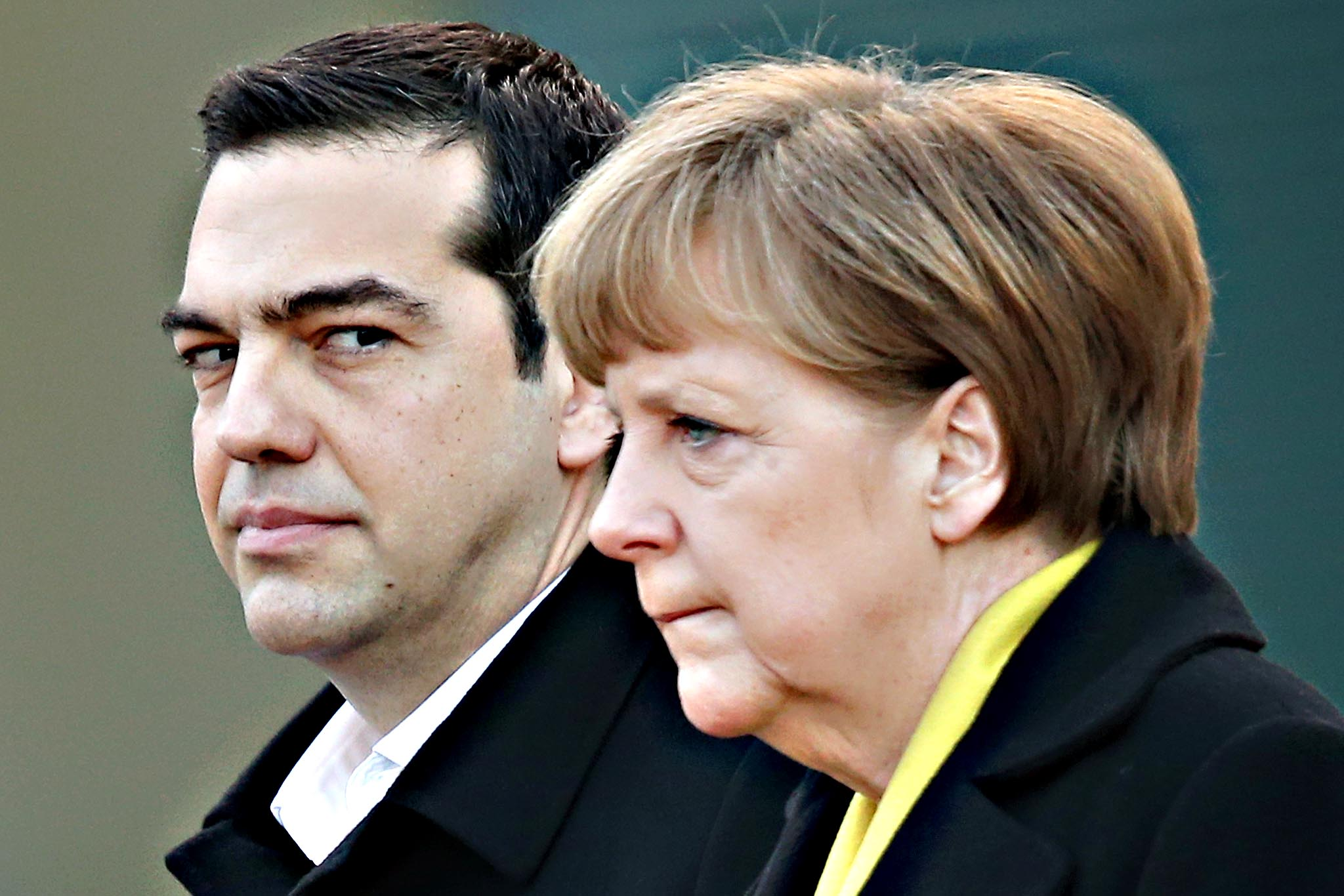 German Chancellor Angela Merkel and Greek Prime Minister Alexis Tsipras listen to their countries' national anthems upon his arrival for talks at the Chancellery on March 23, 2015 in Berlin, Germany. The two leaders are meeting as relations between the Tsipras government and Germany have soured amidst contrary views between the two countries on how Greece can best work itself out of its current economic morass.