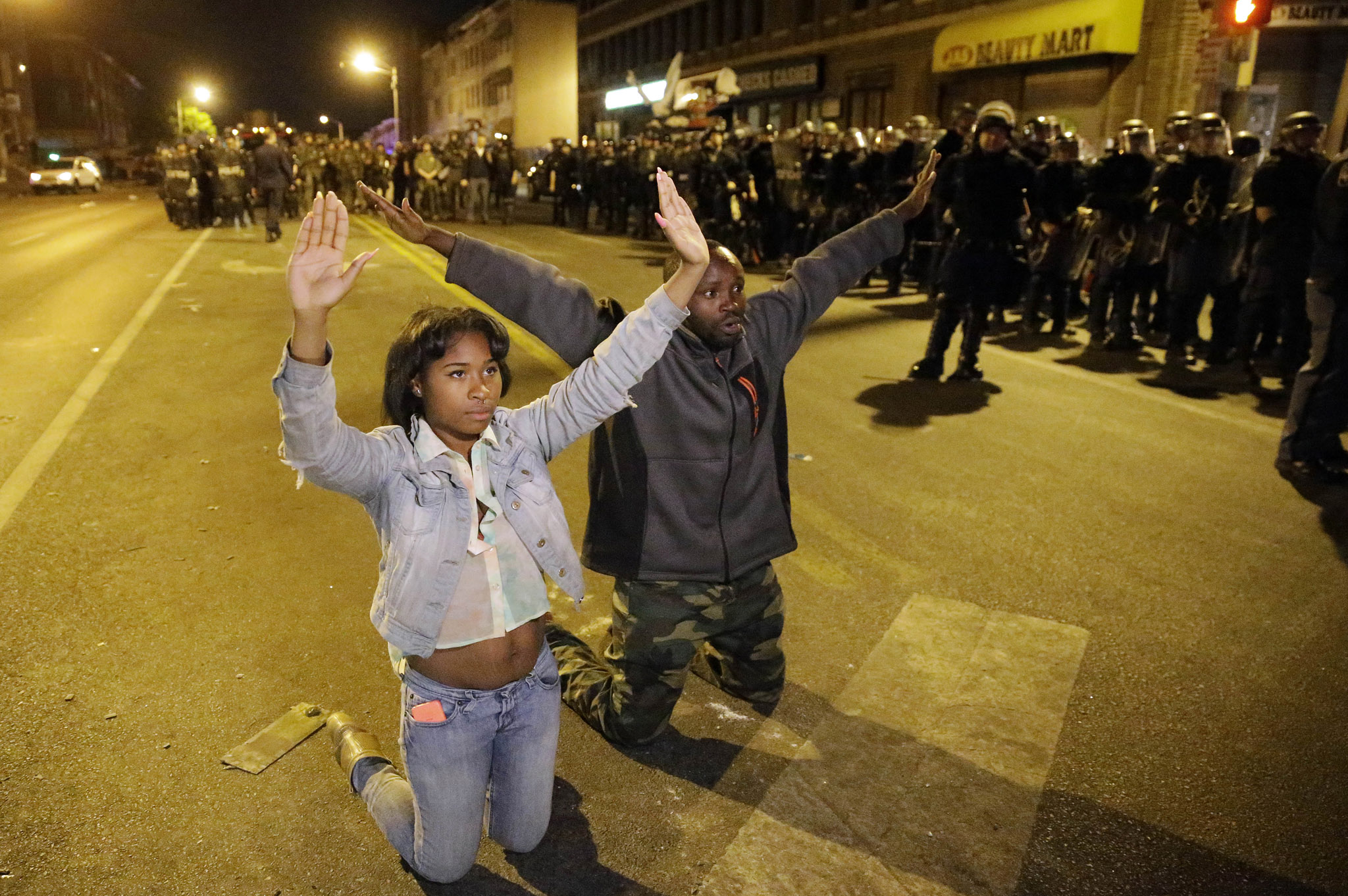 Protesters demonstrate ahead of a 10 p.m. curfew Wednesday, April 29, 2015, in Baltimore. The curfew was imposed after unrest in Baltimore over the death of Freddie Gray while in police custody. (AP Photo/Matt Rourke)