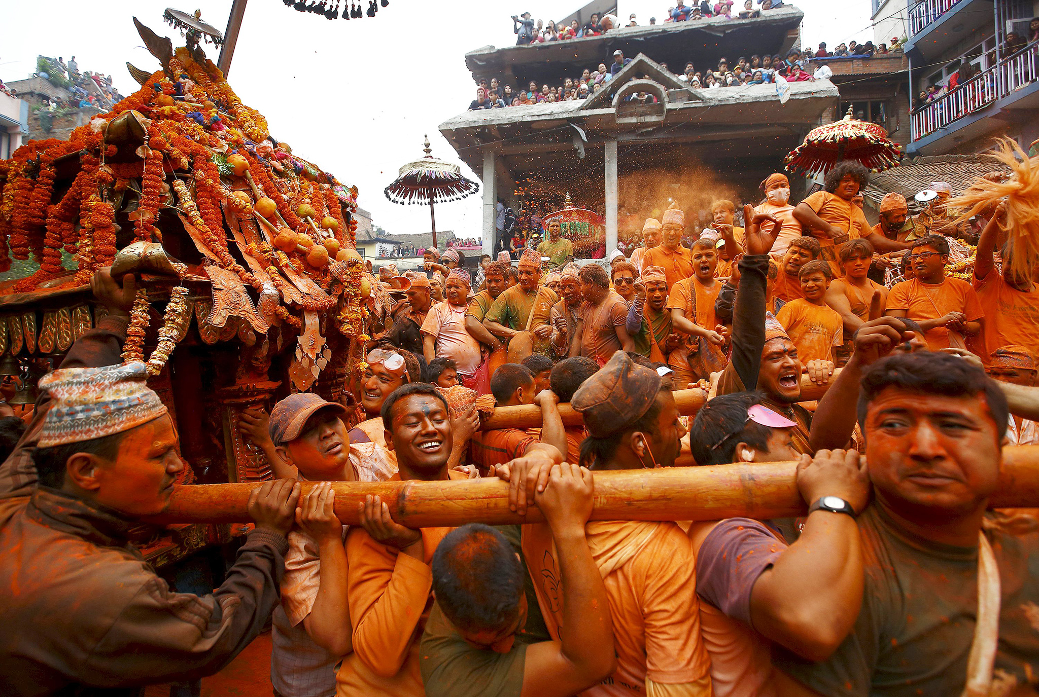"Devotees celebrate ""Sindoor Jatra"" vermillion powder festival at Thimi...Devotees celebrate ""Sindoor Jatra"" vermillion powder festival at Thimi, in Bhaktapur April 15, 2015. The festival is celebrated by singing, dancing, playing traditional instruments, carrying chariots of various deities around the town, offering prayers and throwing vermilion powder over each other to mark the Nepalese New Year and the beginning of the spring season in the country. REUTERS/Navesh Chitrakar"