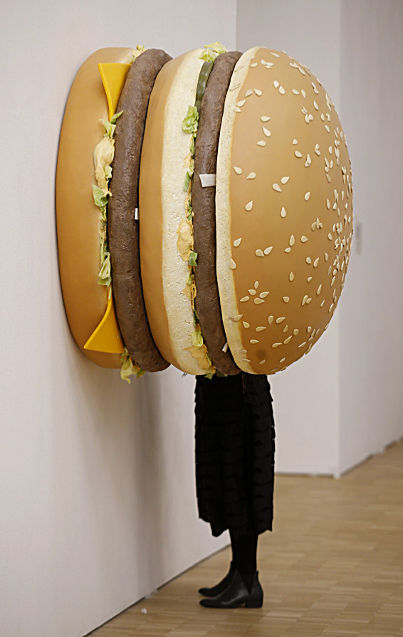 "A woman watches a creation by Tom Friedman 'Big Big Mac' during the unveiling of Arts & Food exhibition at the Triennale in Milan, Italy, Wednesday, April 8, 2015. The exhibition is part of the Expo 2015 in Milan, whose theme is ""Feeding the Planet, Energy for Life"". (AP Photo/Luca Bruno)"