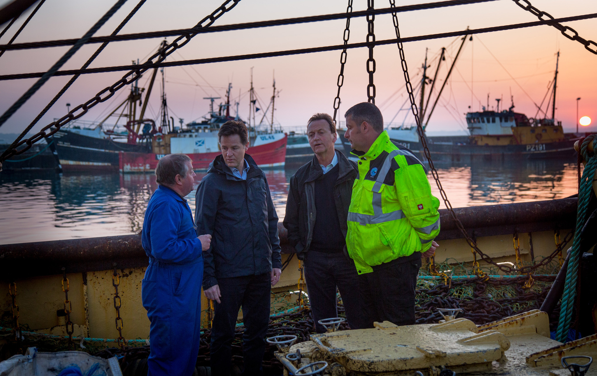 Nick Clegg Campaigns in Cornwall...NEWLYN, ENGLAND - APRIL 21:  Deputy Prime Minister Nick Clegg chats on board a fishing vessel with market manager Lionel Washer (L), Andrew George, MP for St Ives (2R) and Harbour Master Rob Parsons (R) at Newlyn Harbour on April 21, 2015 in Cornwall, England. The Liberal Democrat party leader visited the harbour to campaign alongside Liberal Democrat candidate and MP of 18 years Andrew George and meet members of the fishing community. Britain goes to the polls in a general election on May 7.  (Photo by Matt Cardy/Getty Images)