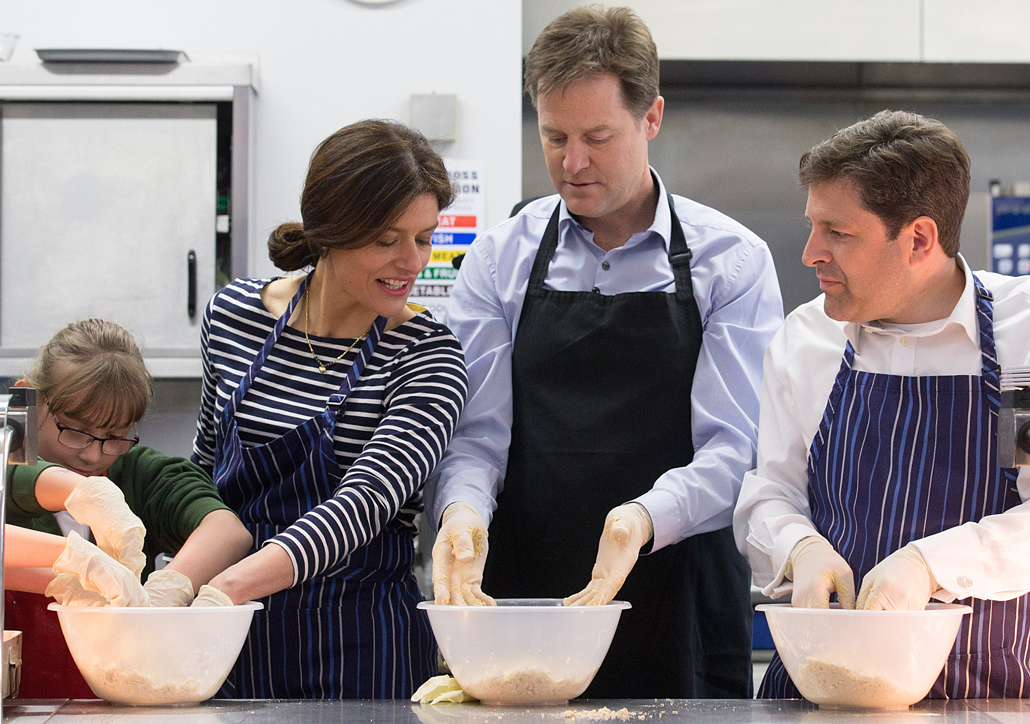 Nick Clegg Visits A West Country School With His Wife...CHIPPENHAM, ENGLAND - APRIL 29:  Deputy Prime Minister Nick Clegg (C) and his wife Miriam Gonzalez Durantez help make a crumble at Ivy Lane Primary School as he canvasses with local Liberal Democrat candidate for Chippenham Duncan Hames (R) on April 29, 2015 in Chippenham, England. As the campaign enters the final days, the country's political parties are stepping up the campaign to appeal for votes from the indecided electorate.  (Photo by Matt Cardy/Getty Images)