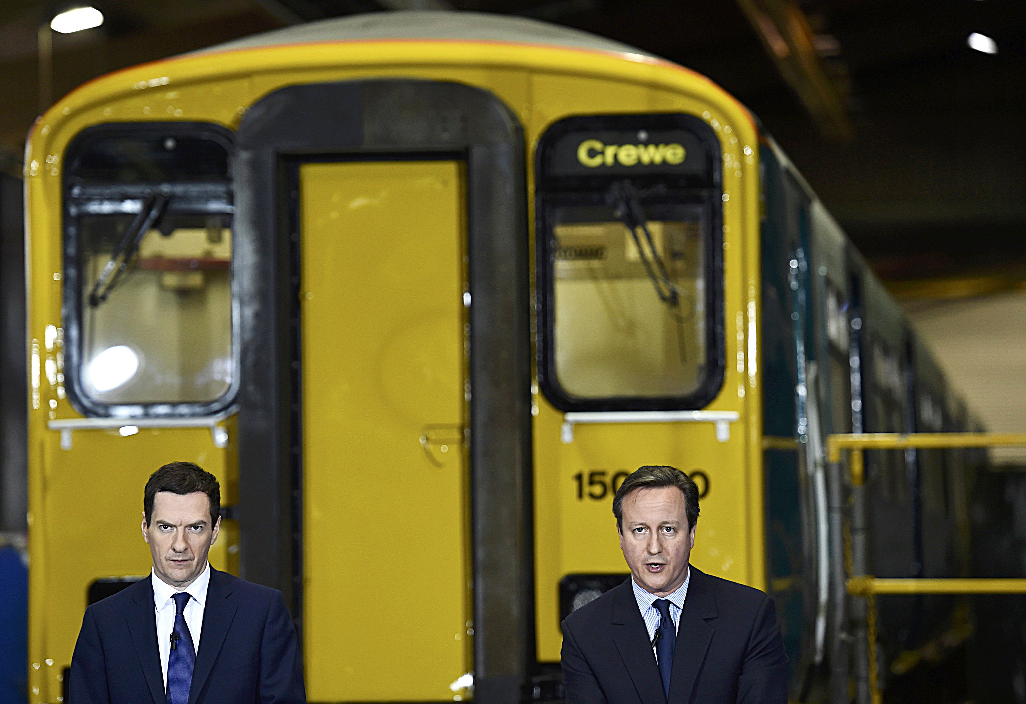 Britain's Prime Minister Cameron delivers a speech with Chancellor of the Exchequer Osborne at Arriva TrainCare in Crewe in northern England...Britain's Prime Minister David Cameron (R) delivers a speech with Chancellor of the Exchequer George Osborne during a campaign stop at Arriva TrainCare in Crewe in northern England, April 20, 2015. REUTERS/Toby Melville