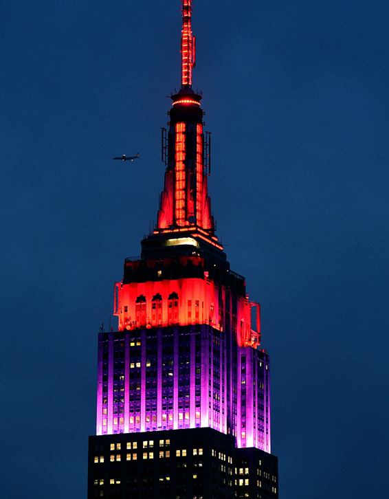 The Empire State Building is lit in red ...The Empire State Building is lit in red and purple April 14, 2015 in New York as part of the effort to bring attention to the 219 missing Nigerian schoolgirls kidnapped by Boko Haram a year ago on April 14, 2014.  AFP PHOTO /  TIMOTHY  A. CLARYTIMOTHY A. CLARY/AFP/Getty Images
