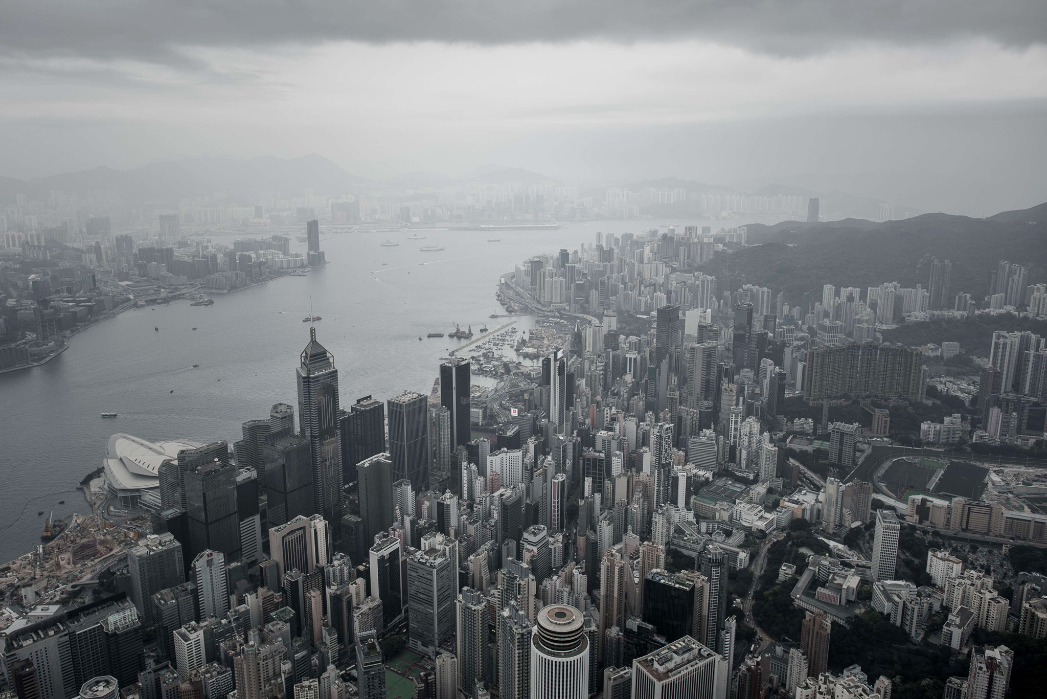 An aerial shot shows the skylines of Hon...An aerial shot shows the skylines of Hong Kong island (foreground) and Kowloon (back L) separated by Victoria harbour on April 23, 2015, a day after the city's government unveiled its Beijing-backed plan for leadership elections in 2017. Britain handed Hong Kong over to China in 1997 under a joint declaration which guaranteed political, social and economic freedoms not enjoyed on the Chinese mainland.  AFP PHOTO / Philippe LopezPHILIPPE LOPEZ/AFP/Getty Images