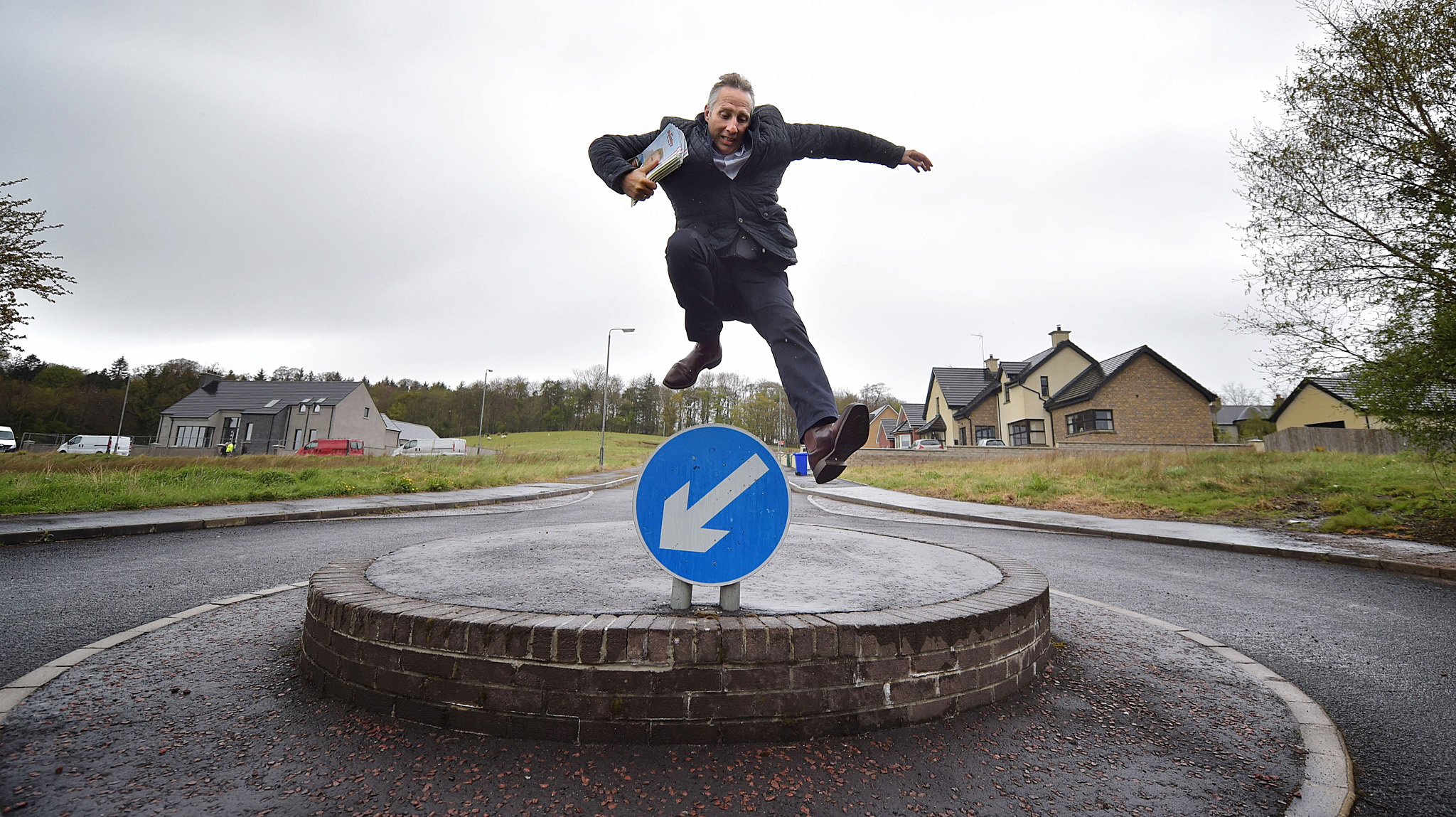 ut On The Campaign Trail With Ian Paisley Junior...BALLYMONEY, NORTHERN IRELAND - APRIL 29:  Democratic Unionist Party Westminster candidate Ian Paisley Jr jumps over a roundabout sign whilst out canvassing on April 29, 2015 in Ballymoney, Northern Ireland. Son of the late Ian Paisley, founder of the DUP and former Northern Ireland First Minister, Paisley Jr successfully ran to succeed his father as the Westminster MP for North Antrim in the 2010 UK general election, winning 46.4% of the vote share. Political observers have suggested that the DUP, with a probable 8-10 Westminster seats could have an influential role to play if the General Election results in a hung parliment. The DUP has said that they are open to working with either the Conservatives or the Labour party.  (Photo by Charles McQuillan/Getty Images)