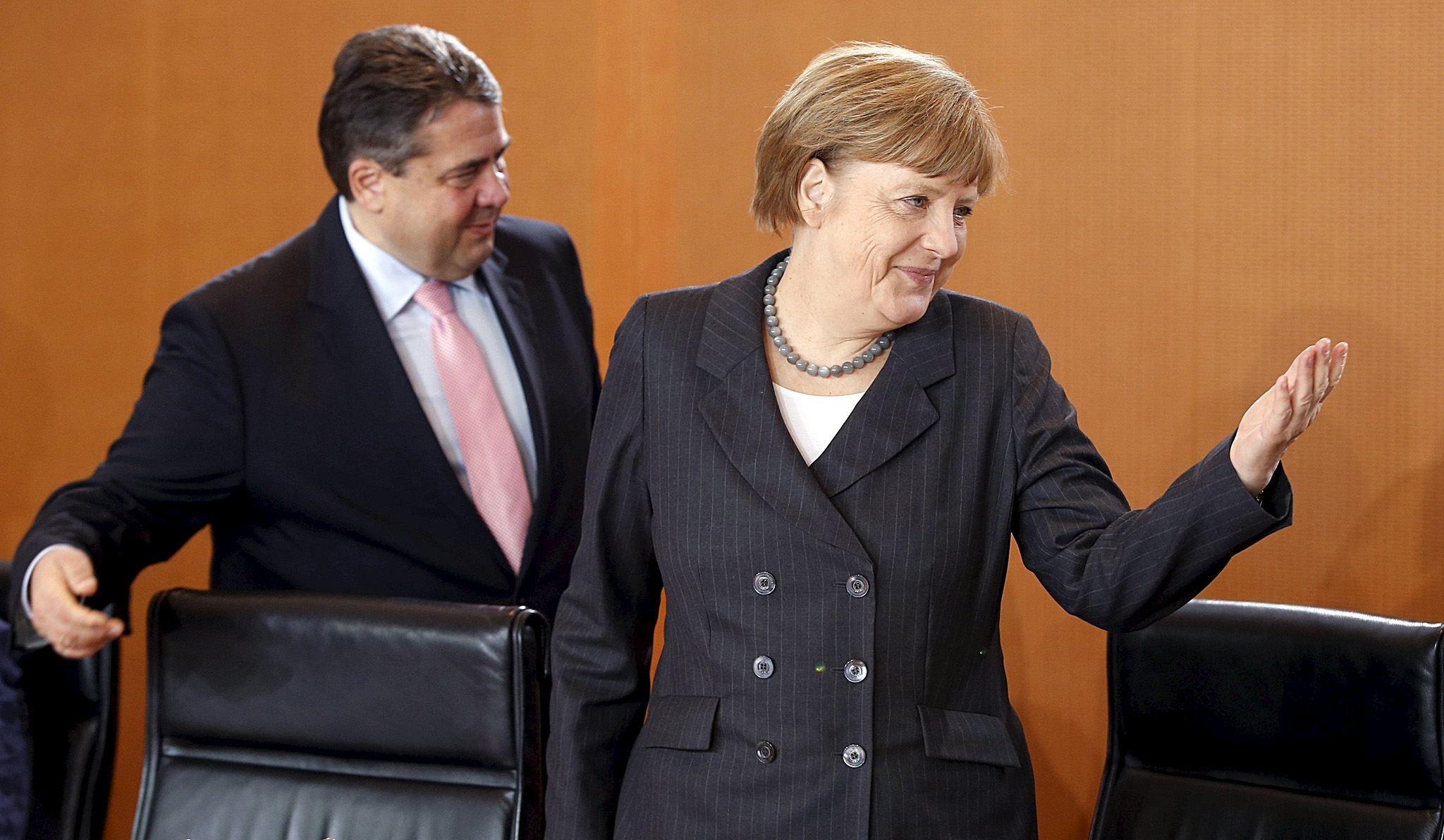 German Chancellor Merkel and Economy Minister Gabriel arrive at a cabinet meeting at the Chancellery in Berlin...German Chancellor Angela Merkel (R) and Economy Minister Sigmar Gabriel arrive at a cabinet meeting at the Chancellery in Berlin, April 1, 2015. Merkel's cabinet signed off on a draft law on Wednesday that imposes an effective ban on the controversial technique of fracking for shale gas.      REUTERS/Fabrizio Bensch