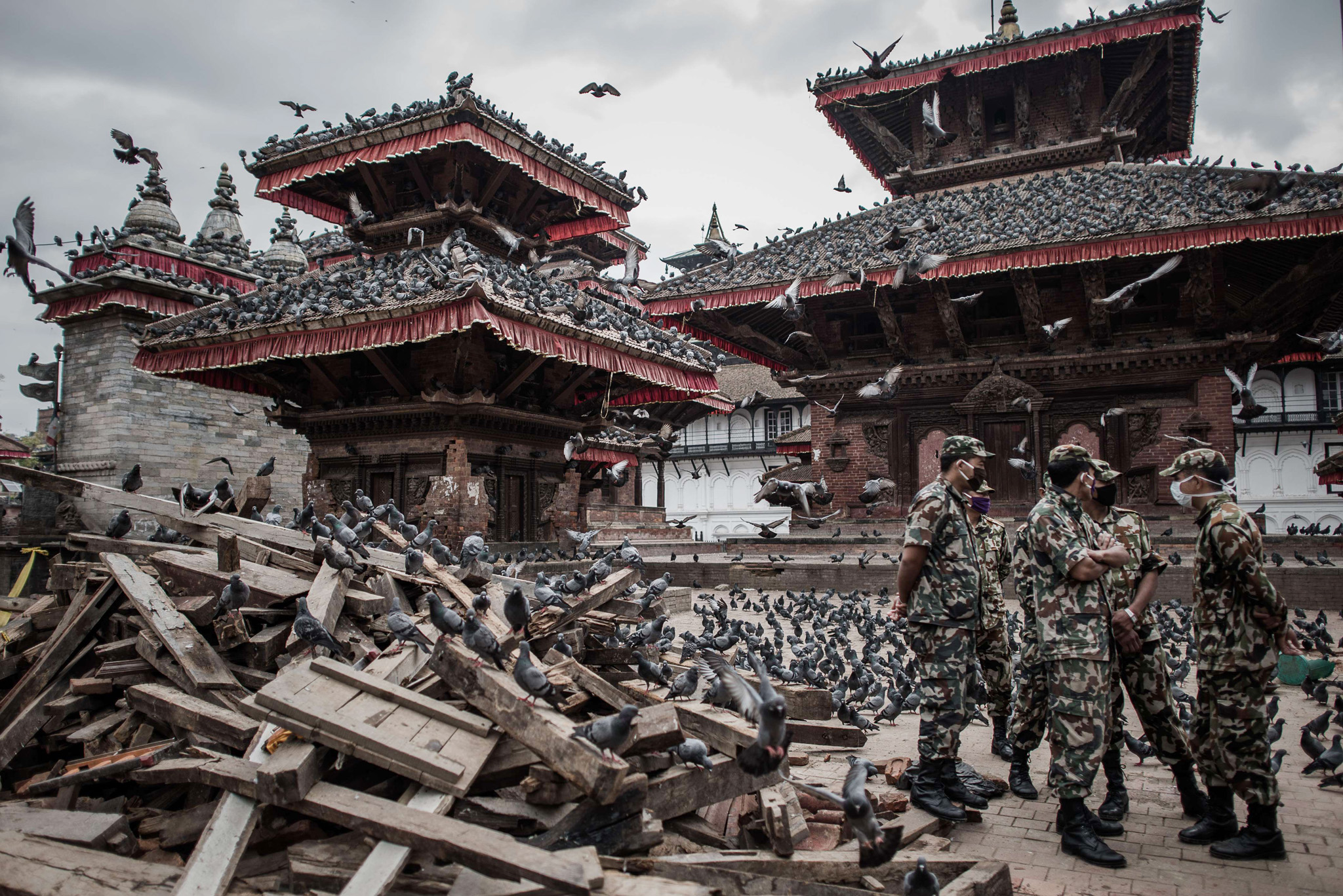 TOPSHOTS Nepalese soldiers stand next to...TOPSHOTS Nepalese soldiers stand next to wrecked buildings at Durbar square, a UNESCO world heritage site that was badly damaged by the earthquake, in the historical centre of Kathmandu on April 29, 2015,  following a 7.8 magnitude earthquake which struck the Himalayan nation on April 25. Rescuers are facing a race against time  to find survivors of a mammoth earthquake that killed more than 5,000 people when it through Nepal five days ago and devastated large parts of one of Asia's poorest nations.    AFP PHOTO / Philippe LopezPHILIPPE LOPEZ/AFP/Getty Images