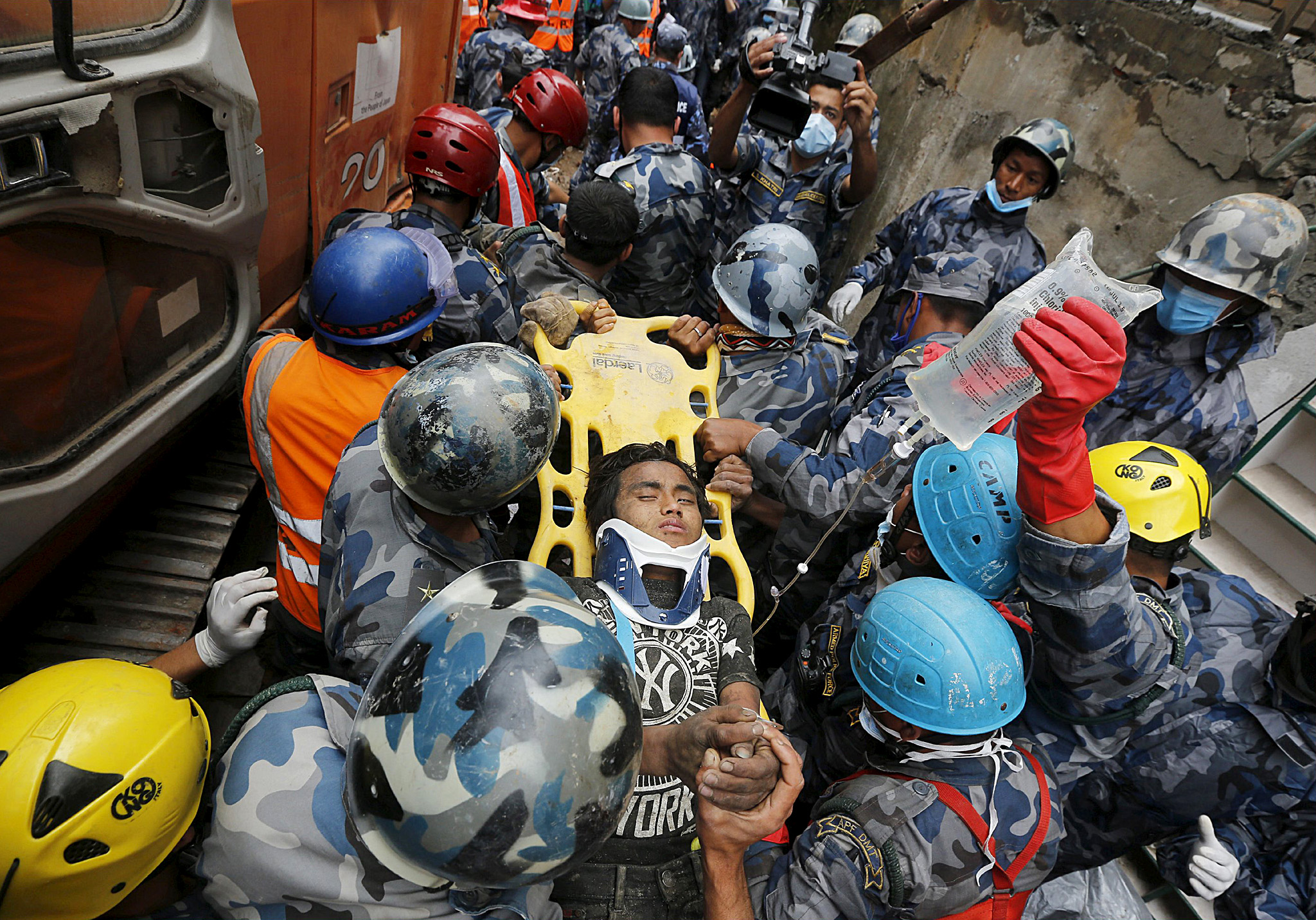"Earthquake survivor is rescued by the Armed Police Force from the collapsed Hilton Hotel, the result of an earthquake in Kathmandu...ATTENTION EDITORS - REUTERS PICTURE HIGHLIGHT Earthquake survivor Pema Lama, 15, is rescued by the Armed Police Force from the collapsed Hilton Hotel, the result of an earthquake in Kathmandu, Nepal April 30, 2015. REUTERS/Adnan Abidi      TPX IMAGES OF THE DAY REUTERS NEWS PICTURES HAS NOW MADE IT EASIER TO FIND THE BEST PHOTOS FROM THE MOST IMPORTANT STORIES AND TOP STANDALONES EACH DAY. Search for ""TPX"" in the IPTC Supplemental Category field or ""IMAGES OF THE DAY"" in the Caption field and you will find a selection of 80-100 of our daily Top Pictures."