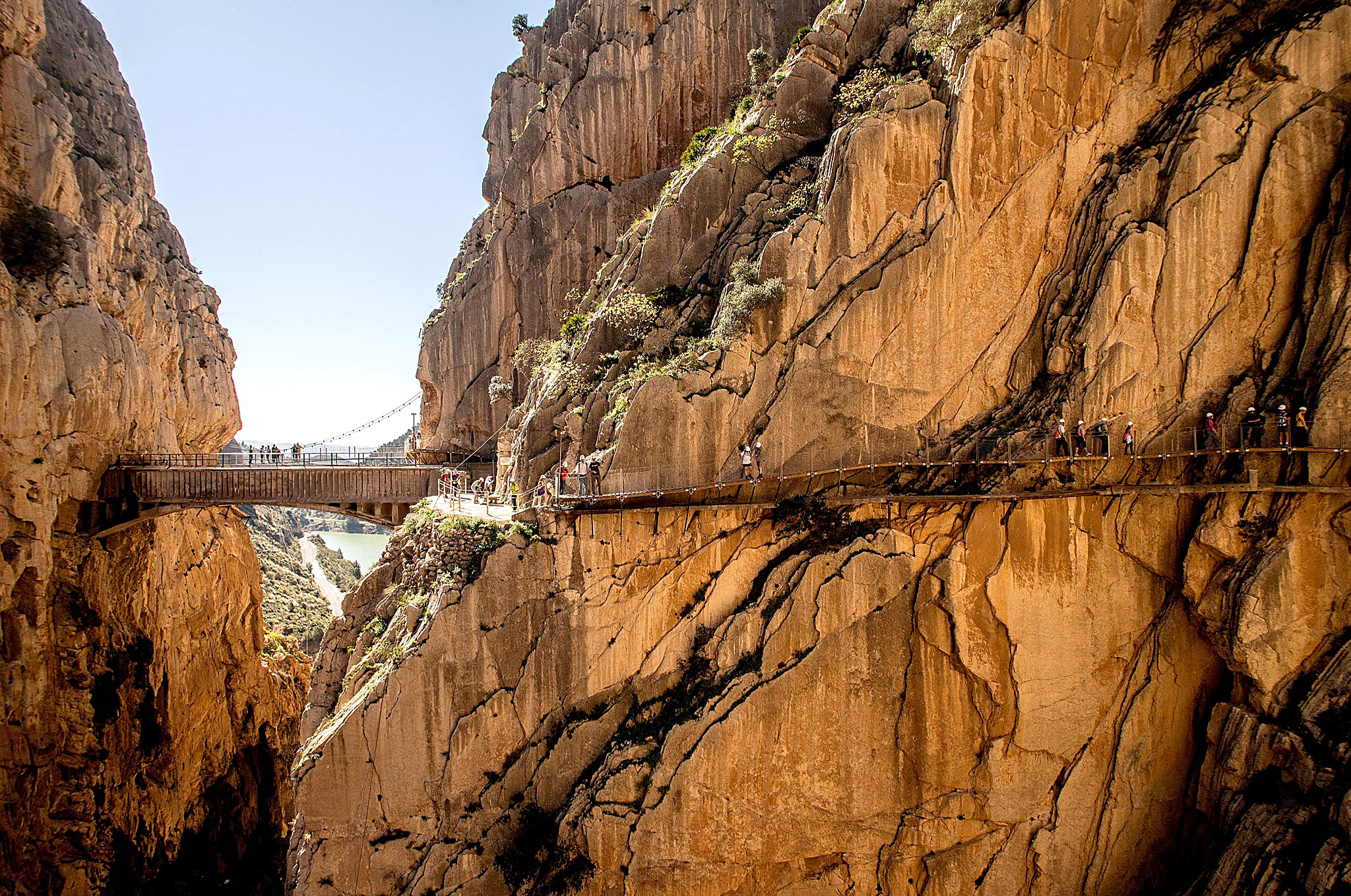 ***BESTPIX*** World's Most Dangerous Footpath Set To Reopen In Spain...MALAGA, SPAIN - APRIL 01:  Tourists walk along the 'El Caminito del Rey' (King's Little Path) footpath on April 1, 2015 in Malaga, Spain. 'El Caminito del Rey', which was built in 1905 and winds through the Gaitanes Gorge, reopened last weekend after a safer footpath was installed above the original. The path, known as the most dangerous footpath in the world, was closed after two fatal accidents in 1999 and 2000. The restoration started in 2011 and reportedly cost 5.5 million euros.  (Photo by David Ramos/Getty Images) ***BESTPIX***