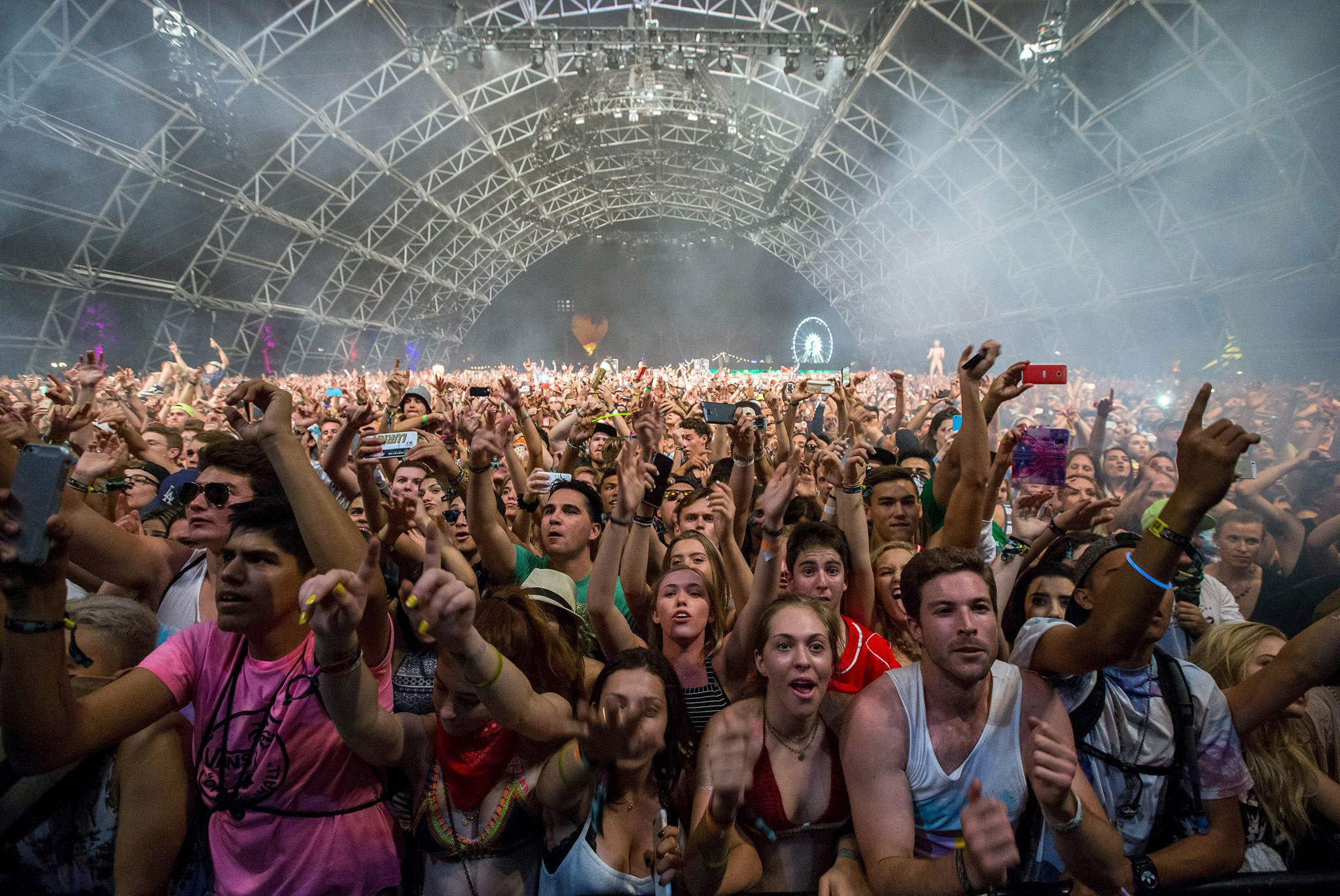 Fans listen to David Guetta at the Coachella Valley Music and Arts Festival in Indio, California.