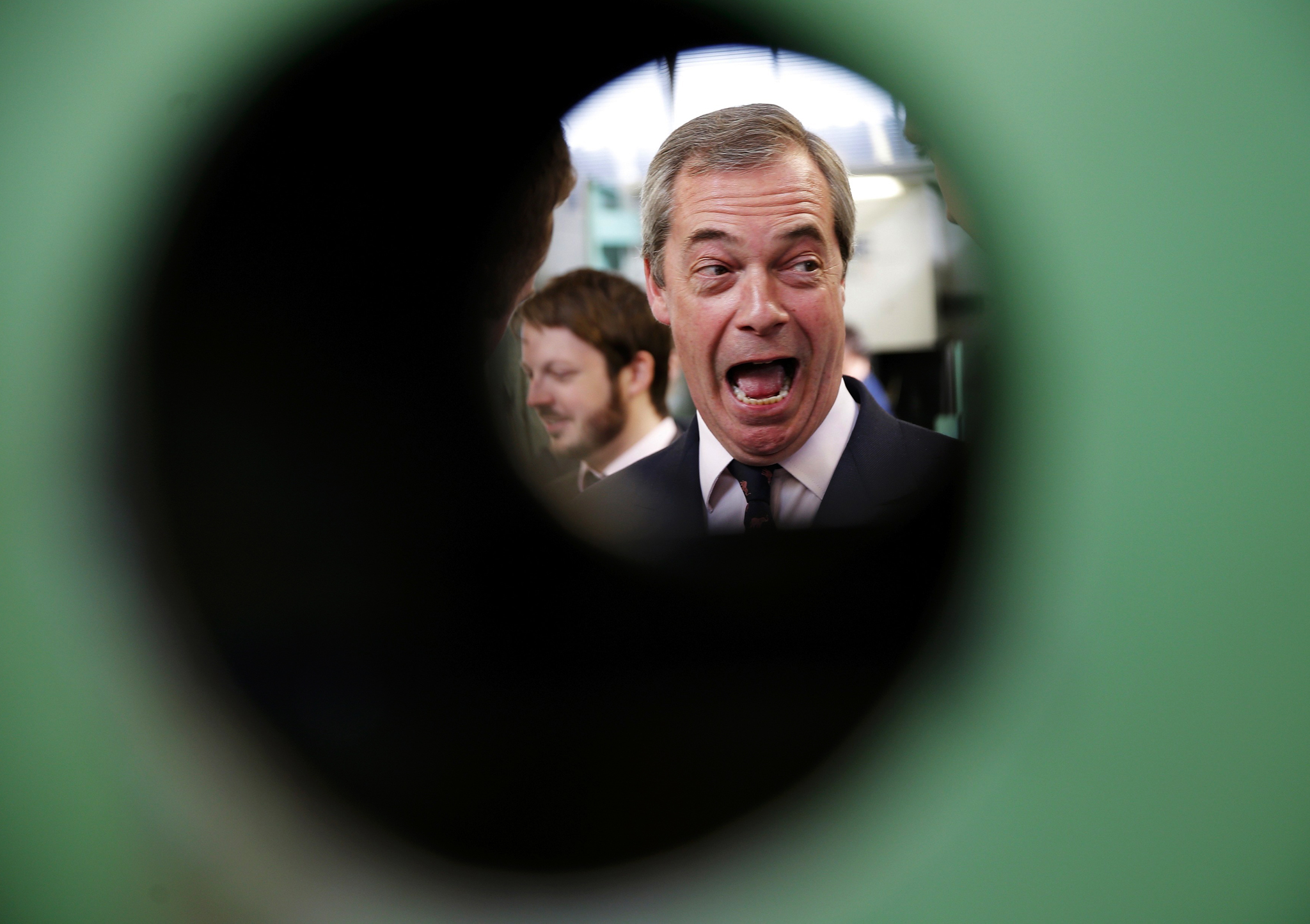 Nigel Farage, the leader of the United Kingdom Independence Party, laughs during a visit to a factory in Clacton, Essex.