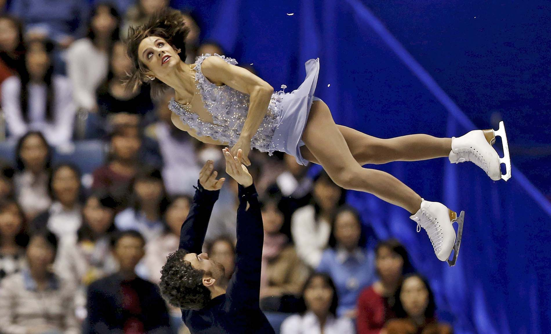 Meagan Duhamel and Eric Radford of Canada compete during the pairs short program at the ISU World Team Trophy in Figure Skating in Tokyo
