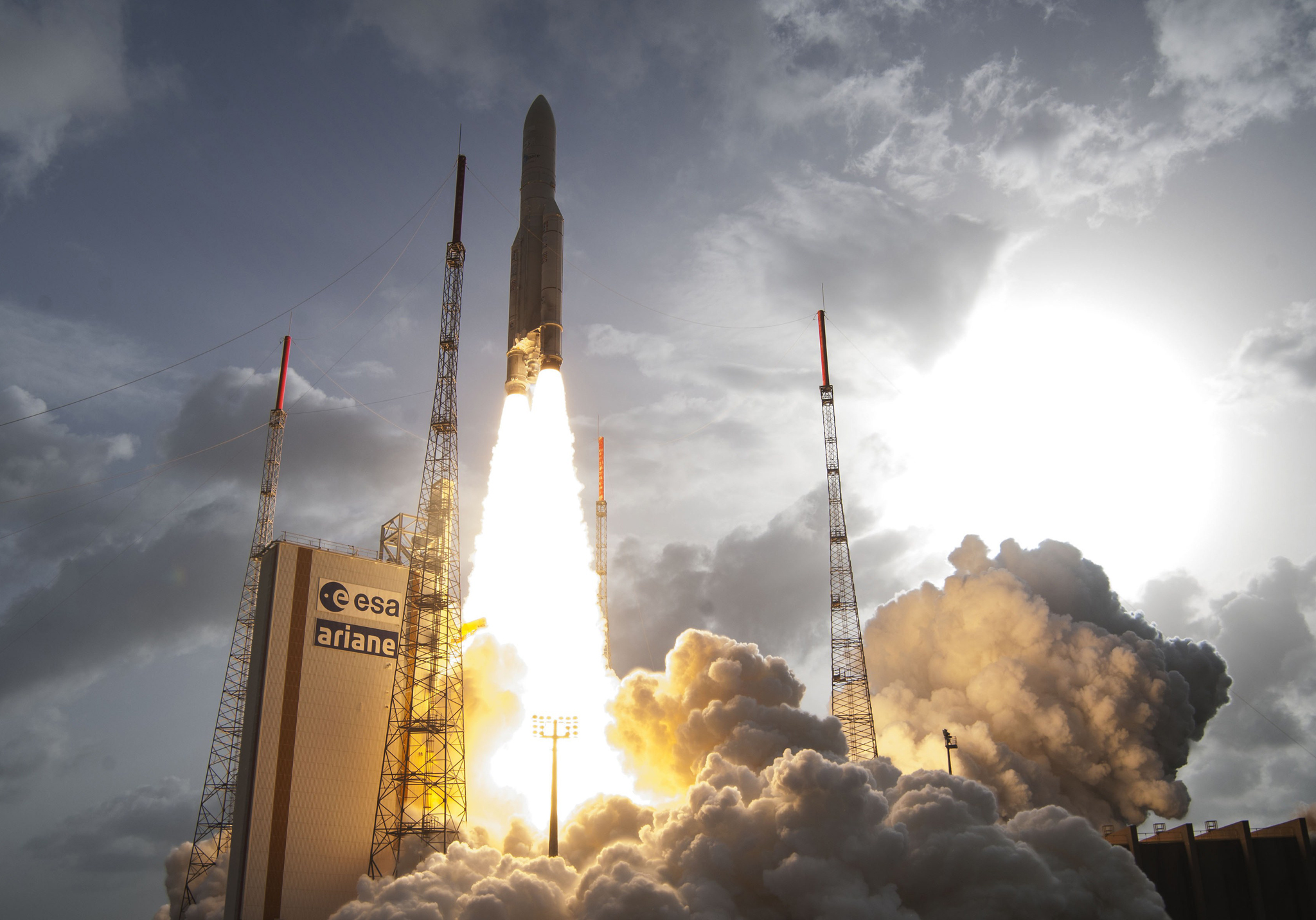 An Ariane 5 rocket lifts off from its launch pad in Kourou, French Guiana, carrying a satellite for Norwegian broadcast and broadband operator Telenor Satellite Broadcasting and a French-Italian military telecommunication satellite.
