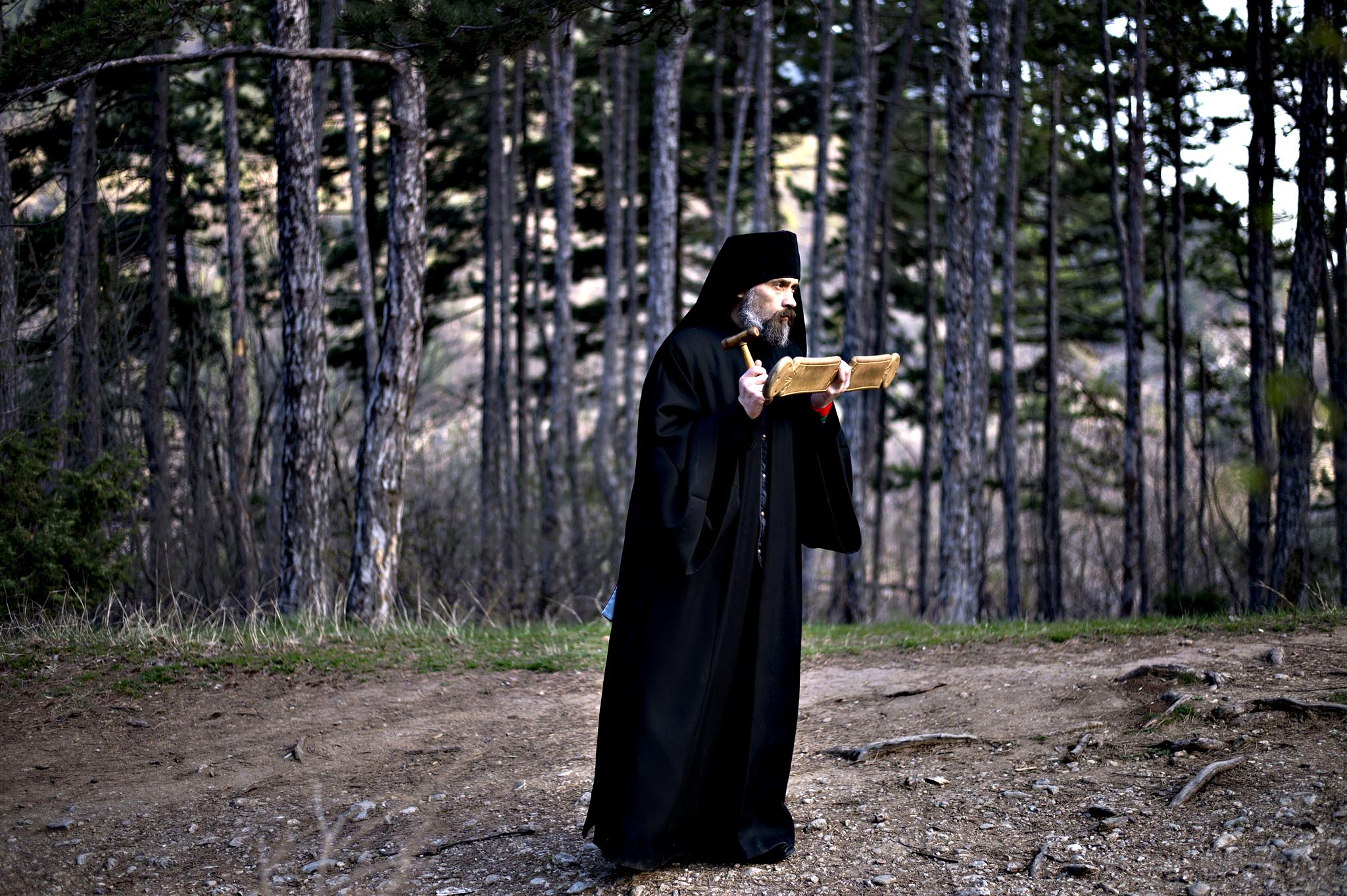 A Bulgarian Orthodox priest leads an annual religious march marking the second day of Easter at the Bachkovo monastery on on April 13, 2015.
