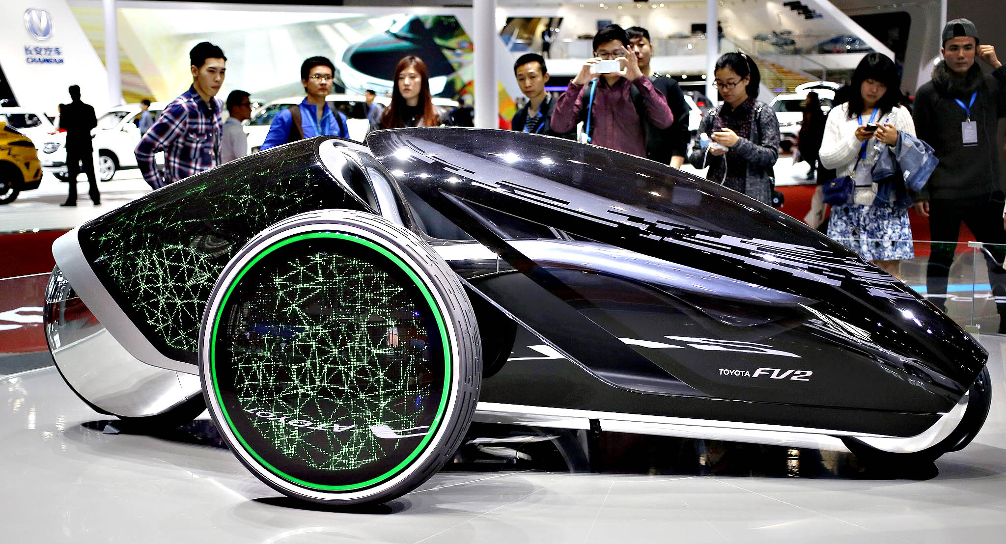 Visitors look at a Toyota FV2 concept car on display at the 16th Shanghai International Automobile Industry Exhibition in Shanghai, China, Tuesday.  The Auto Shanghai international car show opened to the media and runs until 29 April