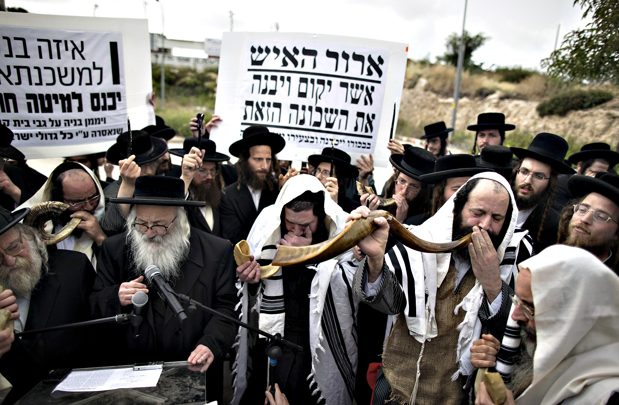 An Ultra-Orthodox Jewish Rabbis wear burlap sacks as a sign of mourning and blowing the Shofar  during a demonstration Prayer in Beit Shemesh, Israel, 16 April 2015. Hundreds of Ultra-Orthodox Jews protested against the construction of new housing units, believing they would be built at the site of ancient Jewish graves.