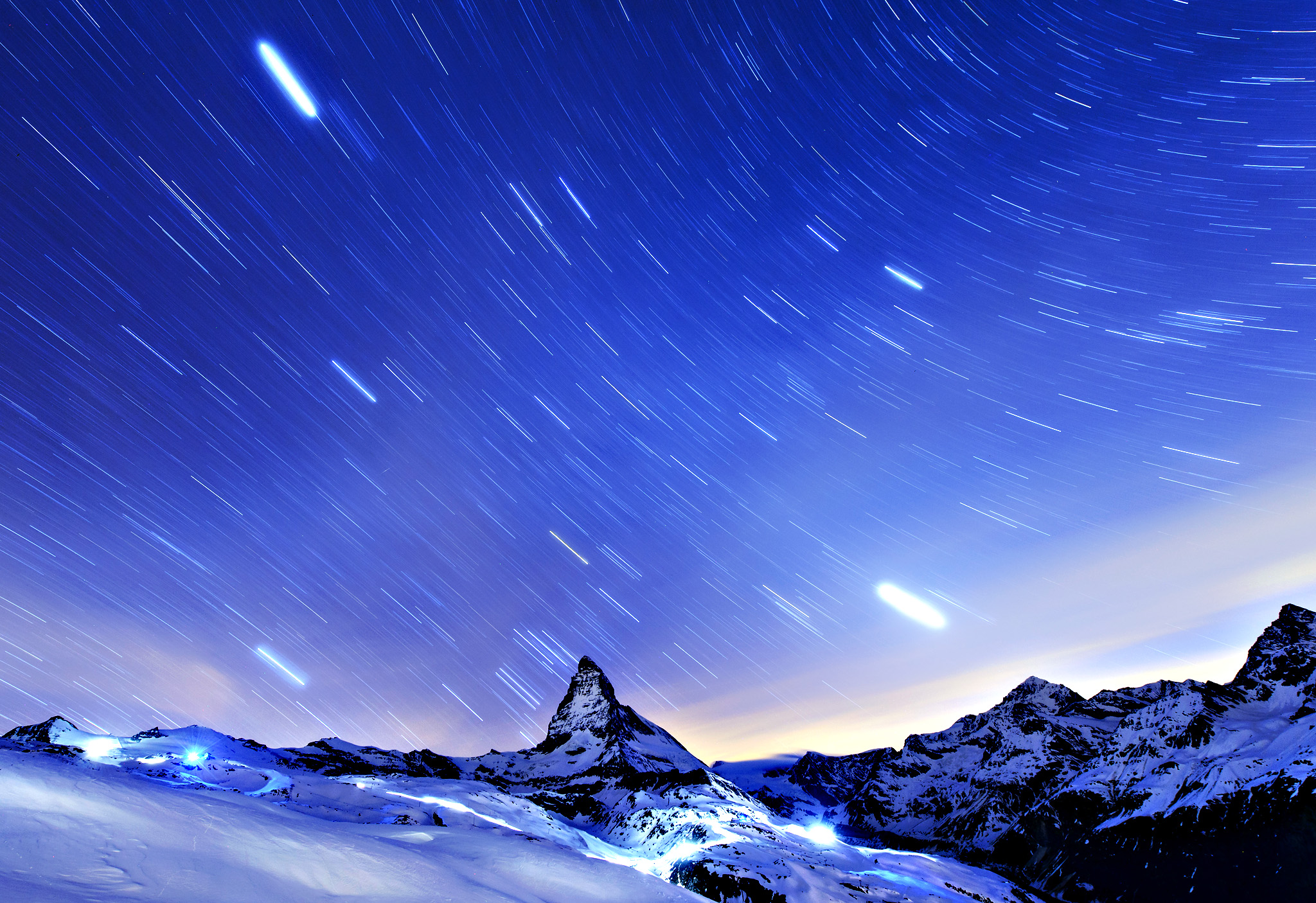 Stars are pictured over the famous Matterhorn mountain, seen from the Riffelberg area, in Zermatt, Switzerland.
