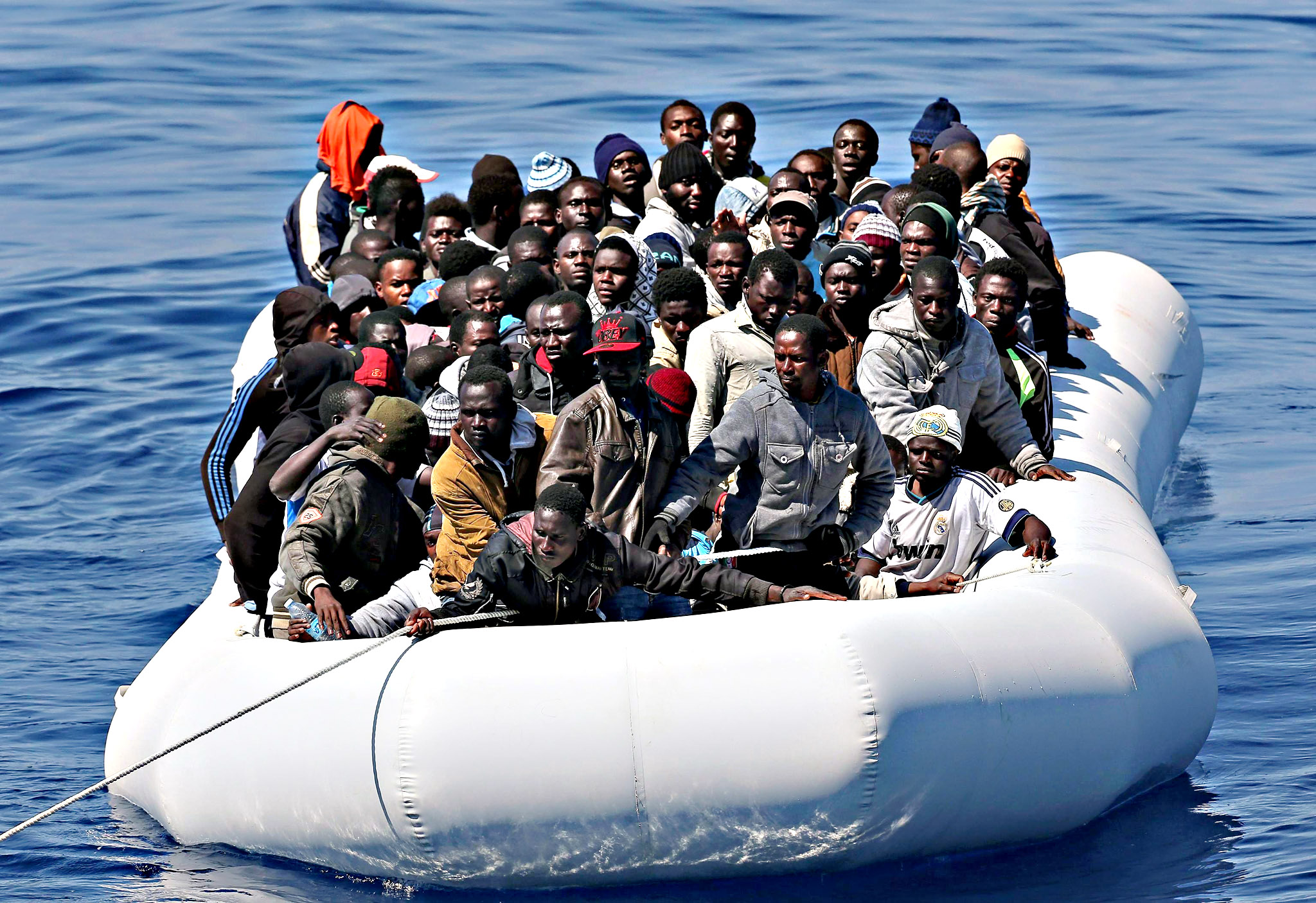 Over 200 illegal migrants, before they are shipped to the Italian mainland after being rescued by Italian Guardia di Finanza boat 'Denaro' in the Mediterranean Sea