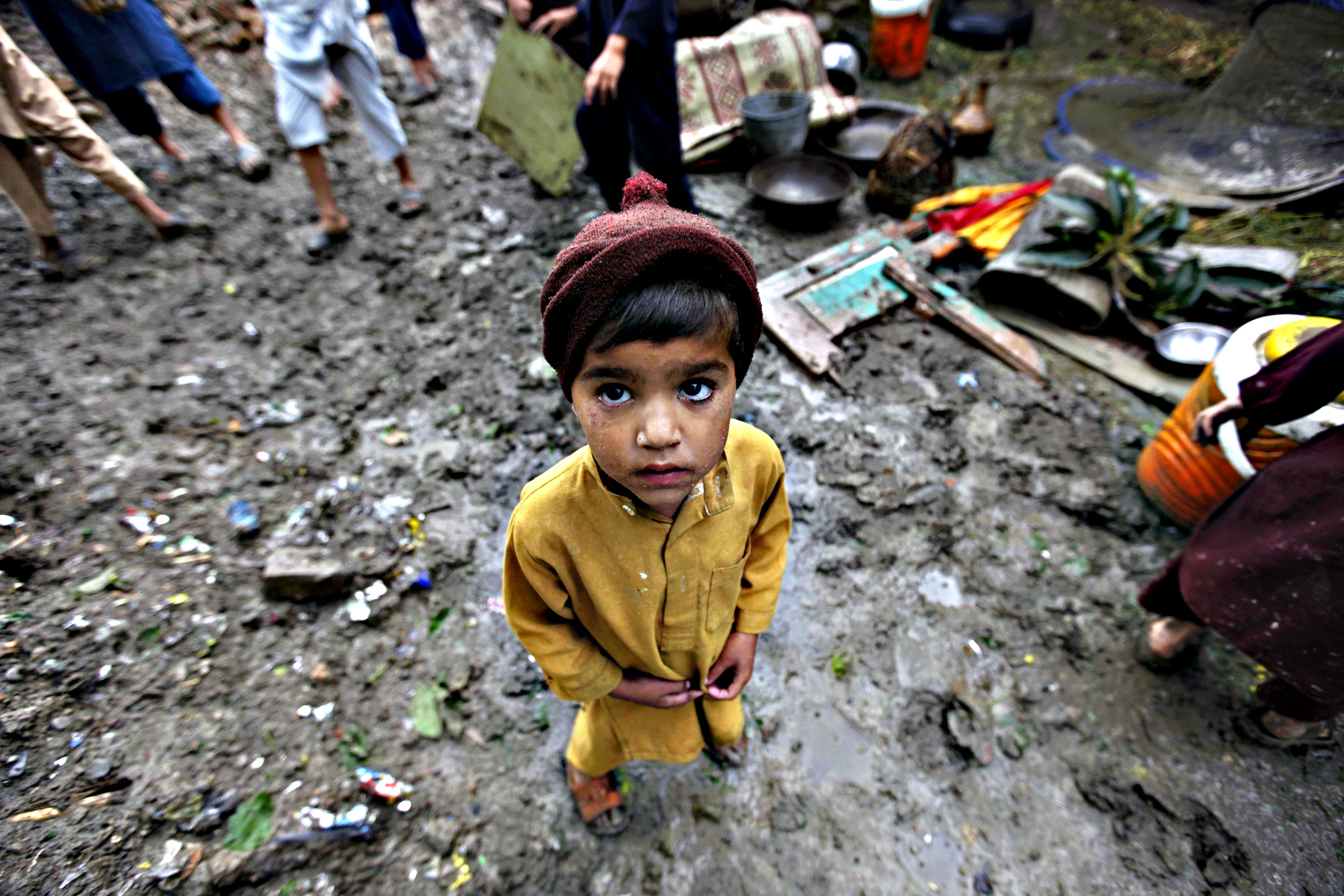"A child looks on at an area affected by torrential rains in Peshawar, Pakistan, 27 April 2015. Rescue workers were scrambling to reach dozens of people believed trapped under collapsed buildings on 27 April after heavy overnight rains and strong winds killed 44 people in north-western Pakistan.  The meteorological department categorized the storm as ""mini tornado or twister,"" warning the government to take more serious steps to tackle climate change especially in northern Himalayan regions"