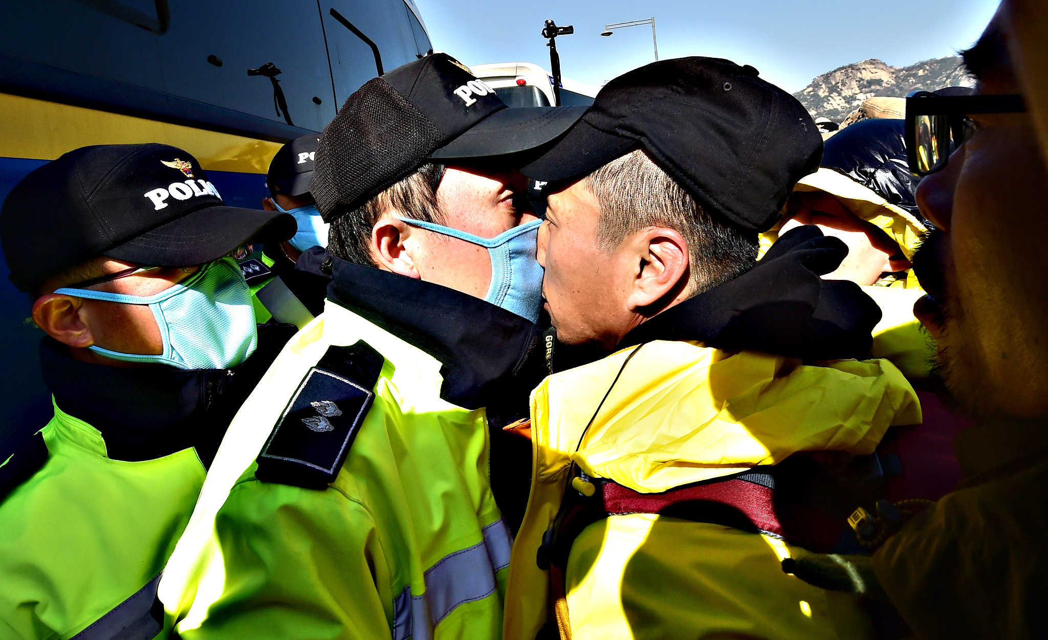 A relative of the victims of South Korea's Sewol ferry disaster is in a nose-to-nose stand-off with a policeman during an anti-government protest near the presidential residence in Seoul on April 17, 2015. Dozens of people continued their protests overnight after thousands of mourners rallied to mark the first anniversary of the disaster that claimed 304 lives.
