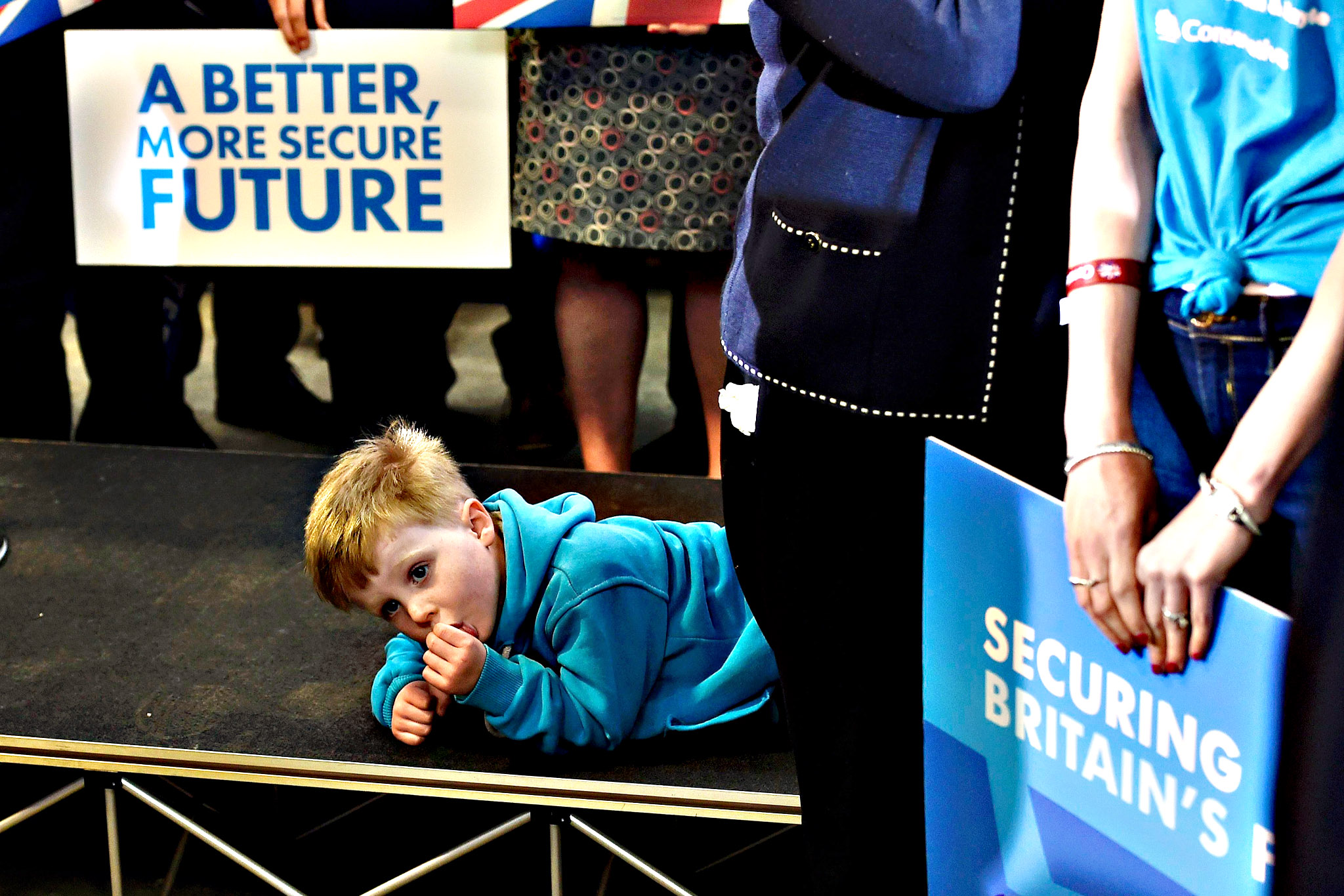 A child of a party activist waits for Britain's Prime Minister David Cameron to deliver a speech at a regional campaign launch in Penzance on Thursday in Penzance, England. Britain goes to the polls in a General Election on May 7