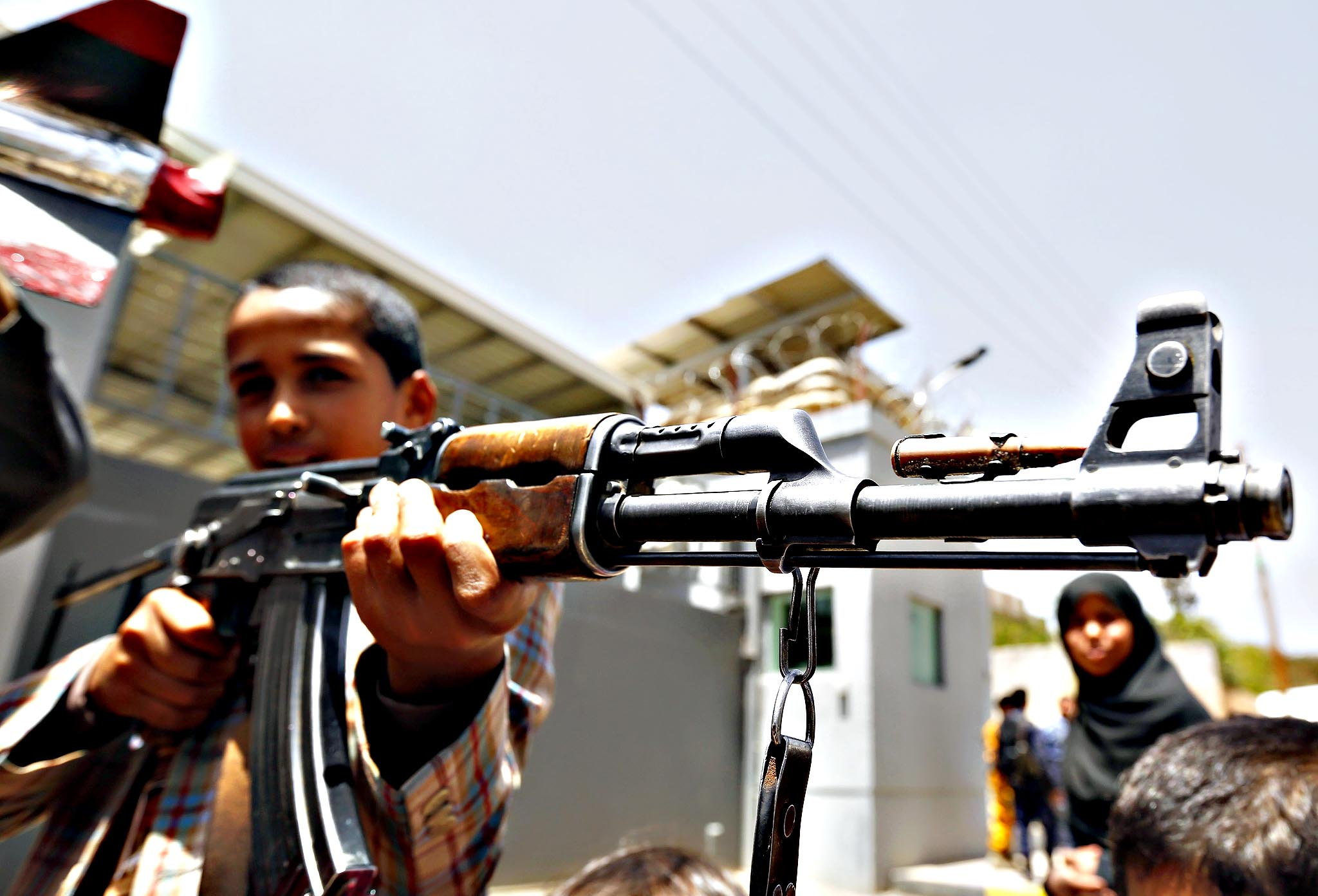 A young Yemeni poses with a gun during a protest against Saudi-led airstrikes on Yemen, outside the Sana a-based UN offices in Sana a, Yemen, 13 April 2015. According to reports, Yemeni students rallied outside the Sana a-based UN offices, calling for an end of the Saudi-led military Decisive Storm operation, accusing the Saudi-led coalition of attacking schools and civilian houses throughout Yemen in their bid the degrade the capabilities of the Houthis and their allies.
