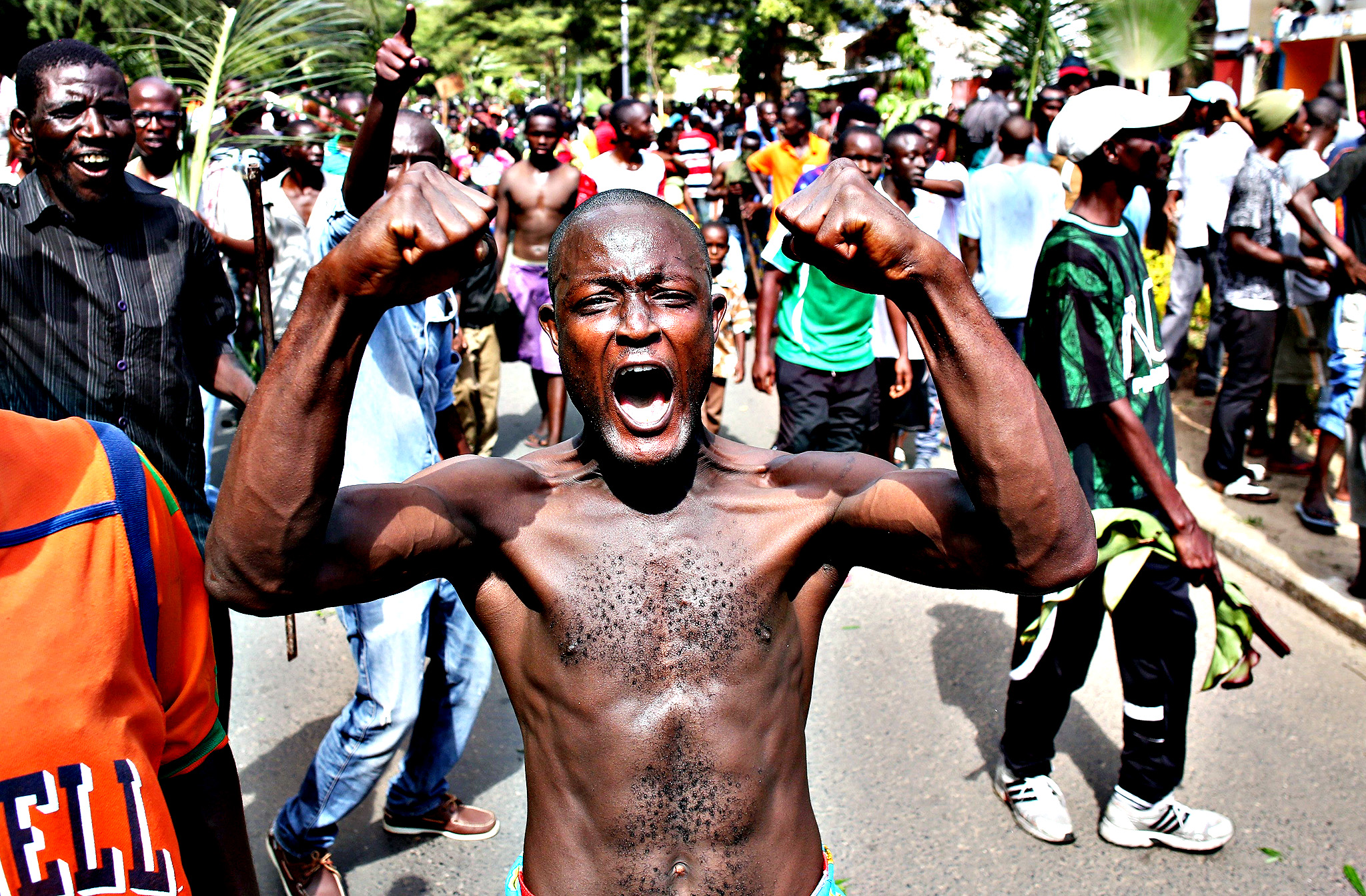 A man gestures as he celebrates in Bujumbura, Burundi.  Crowds poured onto the streets of Burundi's capital on Wednesday to celebrate after a general said he was dismissing President Pierre Nkurunziza for violating the constitution by seeking a third term in office