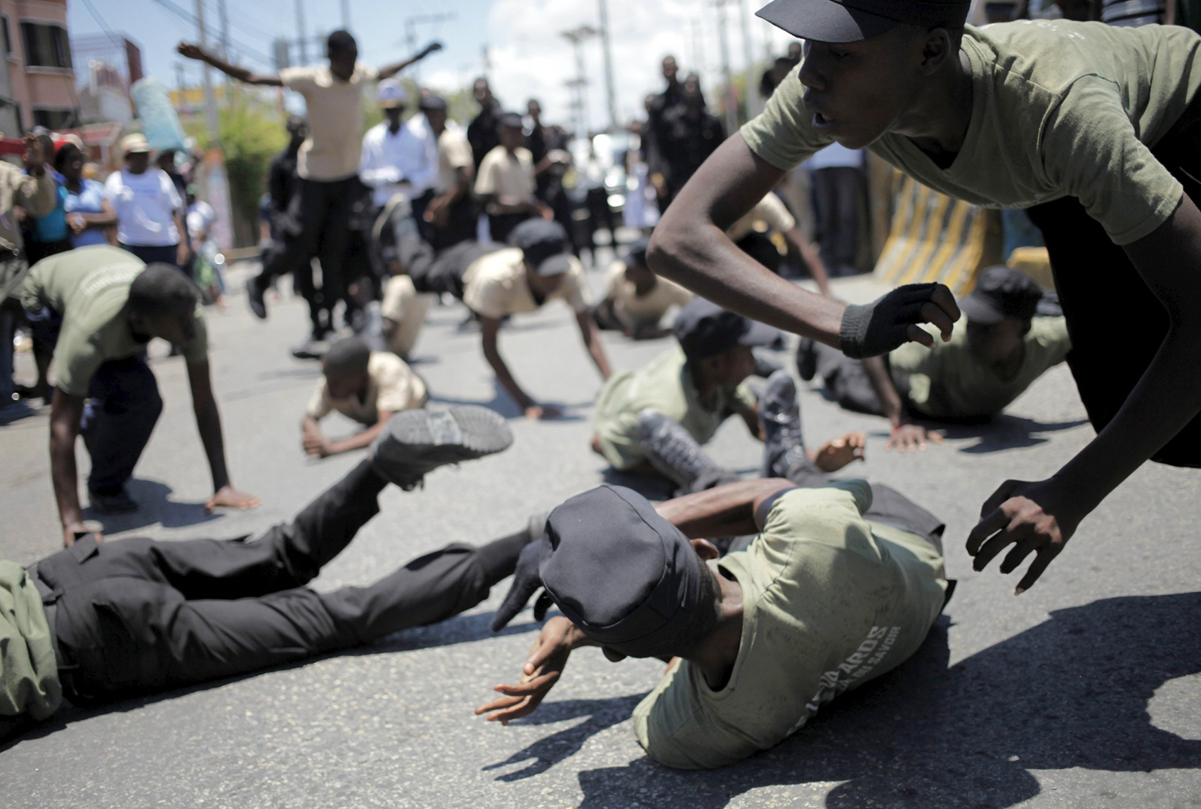 Haitian children show their skills during a march in celebrations for National Haitian Flag Day in the streets of Port-au-Prince