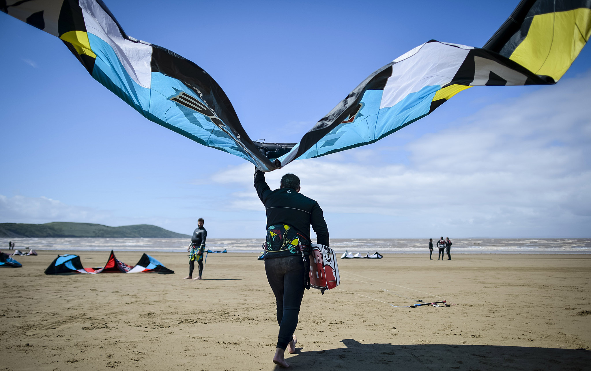 Spring weather May 12th 2015...Windsurfers and kitesurfers prepare their kites and boards as near perfect conditions are present at Weston-super-Mare beach on a warm and windy day in the Bristol Channel, Somerset. PRESS ASSOCIATION Photo. Picture date: Tuesday May 12, 2015. Photo credit should read: Ben Birchall/PA Wire