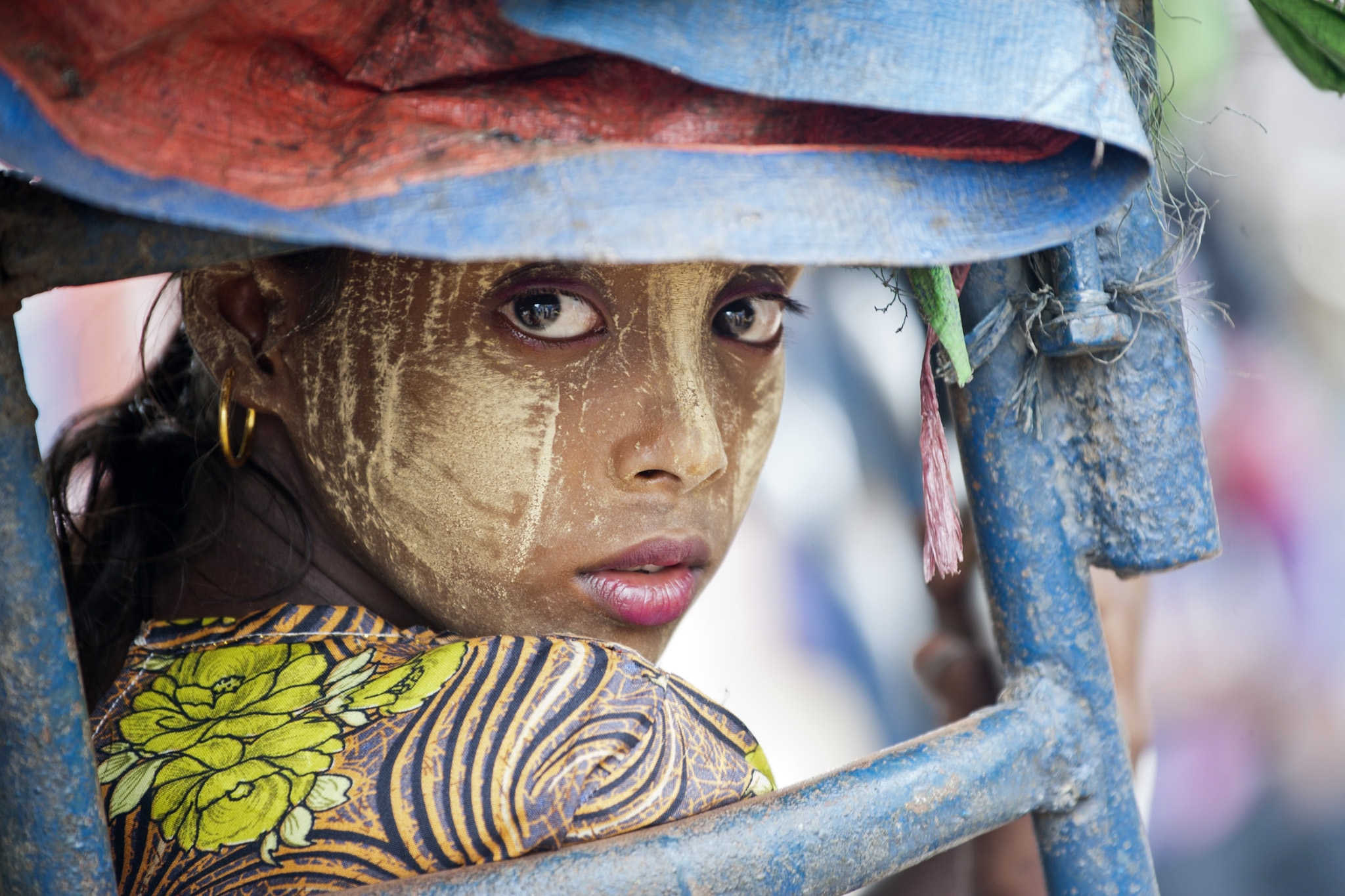 This photo taken on May 21, 201...TOPSHOTS This photo taken on May 21, 2015 shows an ethnic Rohingya Muslim woman looking back as she rides a tuk tuk near a camp set up outside the city of Sittwe in Myanmar's Rakhine state. Malaysia ordered search and rescue missions on May 22 for thousands of boatpeople stranded at sea, as Myanmar hosted talks with US and Southeast Asian envoys on the migrant exodus from its shores.  AFP PHOTO / YE AUNG THUYe Aung Thu/AFP/Getty Images