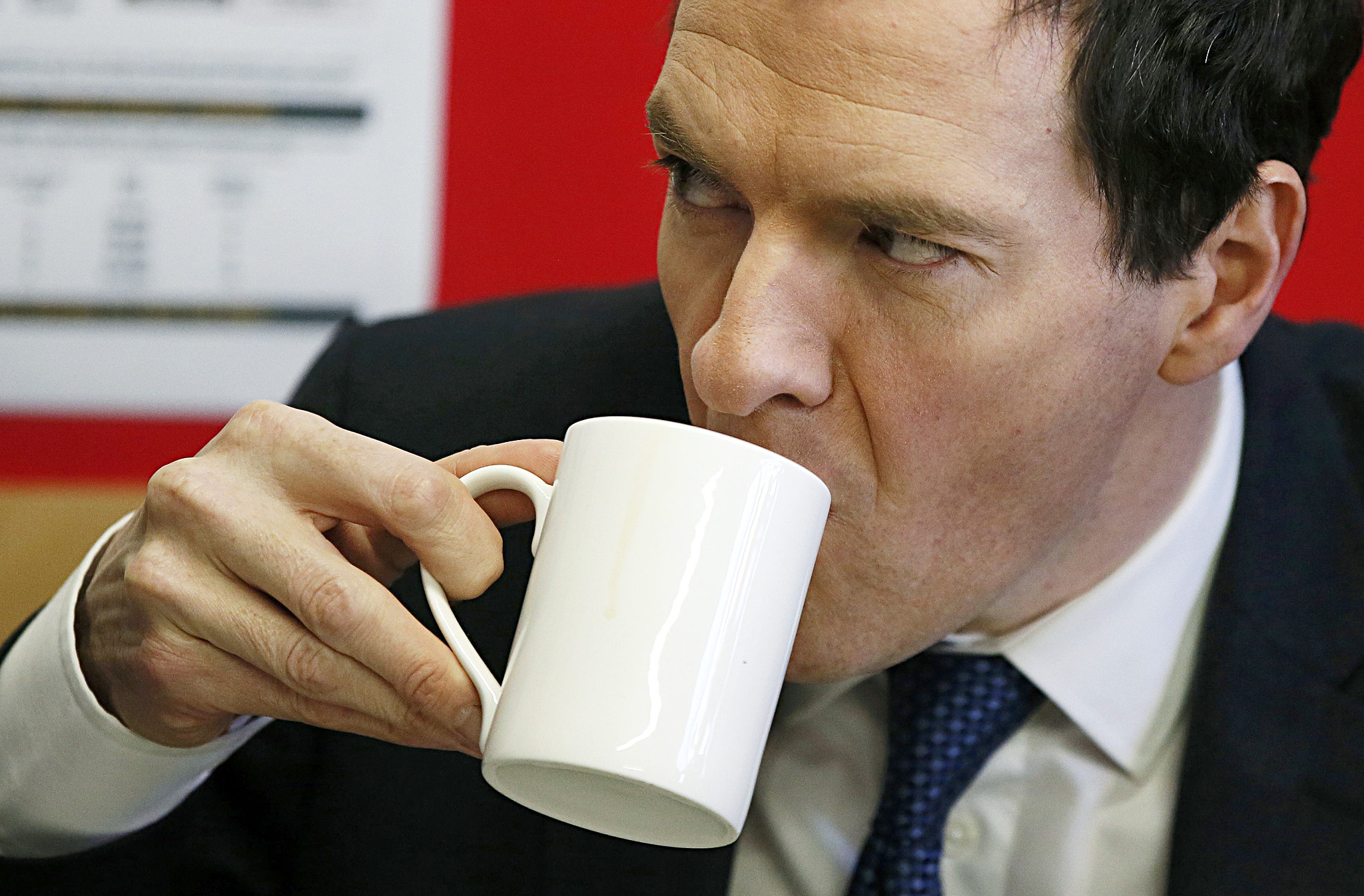 Britain's Chancellor of the Exchequer George Osborne drinks a mug of tea during a visit to the DPD parcels depot in Raunds...Britain's Chancellor of the Exchequer George Osborne drinks a mug of tea during a visit to the DPD parcels depot in Raunds, Britain May 6, 2015. Britain will go to the polls in a national election on May 7. REUTERS/Phil Noble