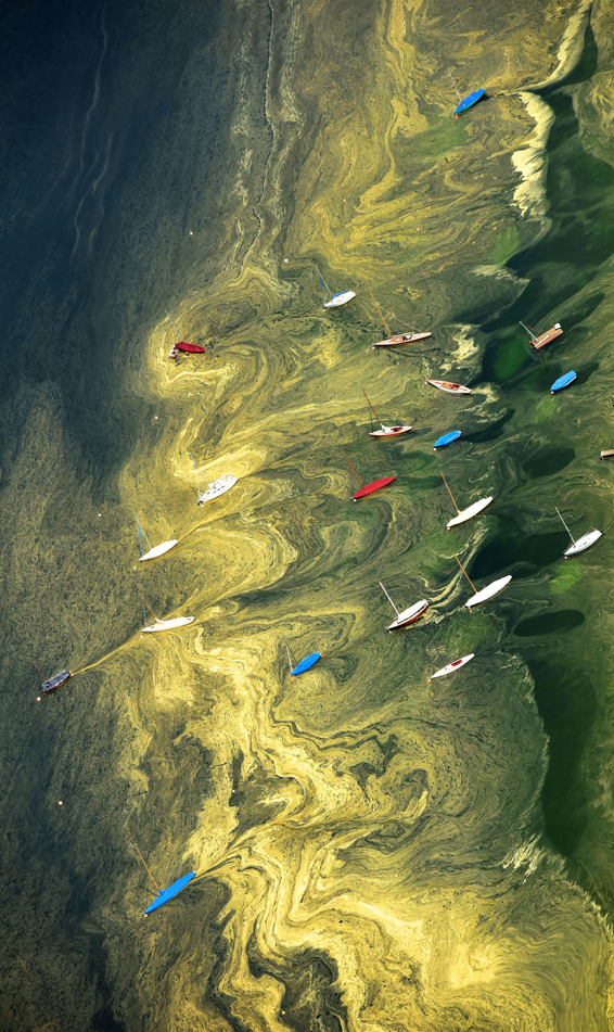 Aerial view of sailing boats that lay in...Aerial view of sailing boats that lay in the water of Lake Starnberg which water is covered with pollen near Starnberg, southern Germany, on May 8, 2015.  AFP PHOTO / DPA / PETER KNEFFEL +++ GERMANY OUTPETER KNEFFEL/AFP/Getty Images