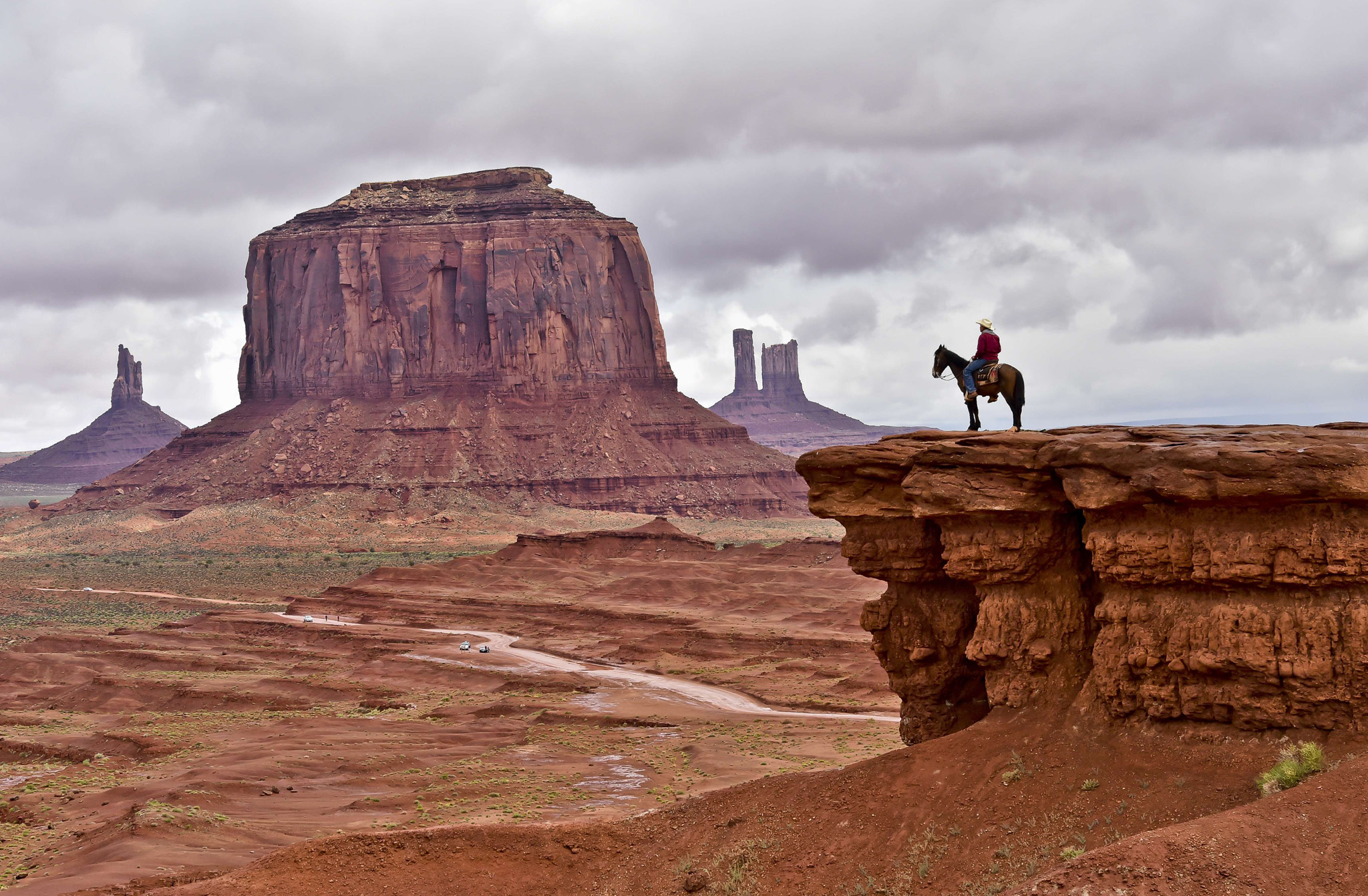 A Navajo man on a horse poses for touris...A Navajo man on a horse poses for tourists in front of the Merrick Butte in Monument Valley Navajo Tribal Park, Utah, on May 16, 2015.