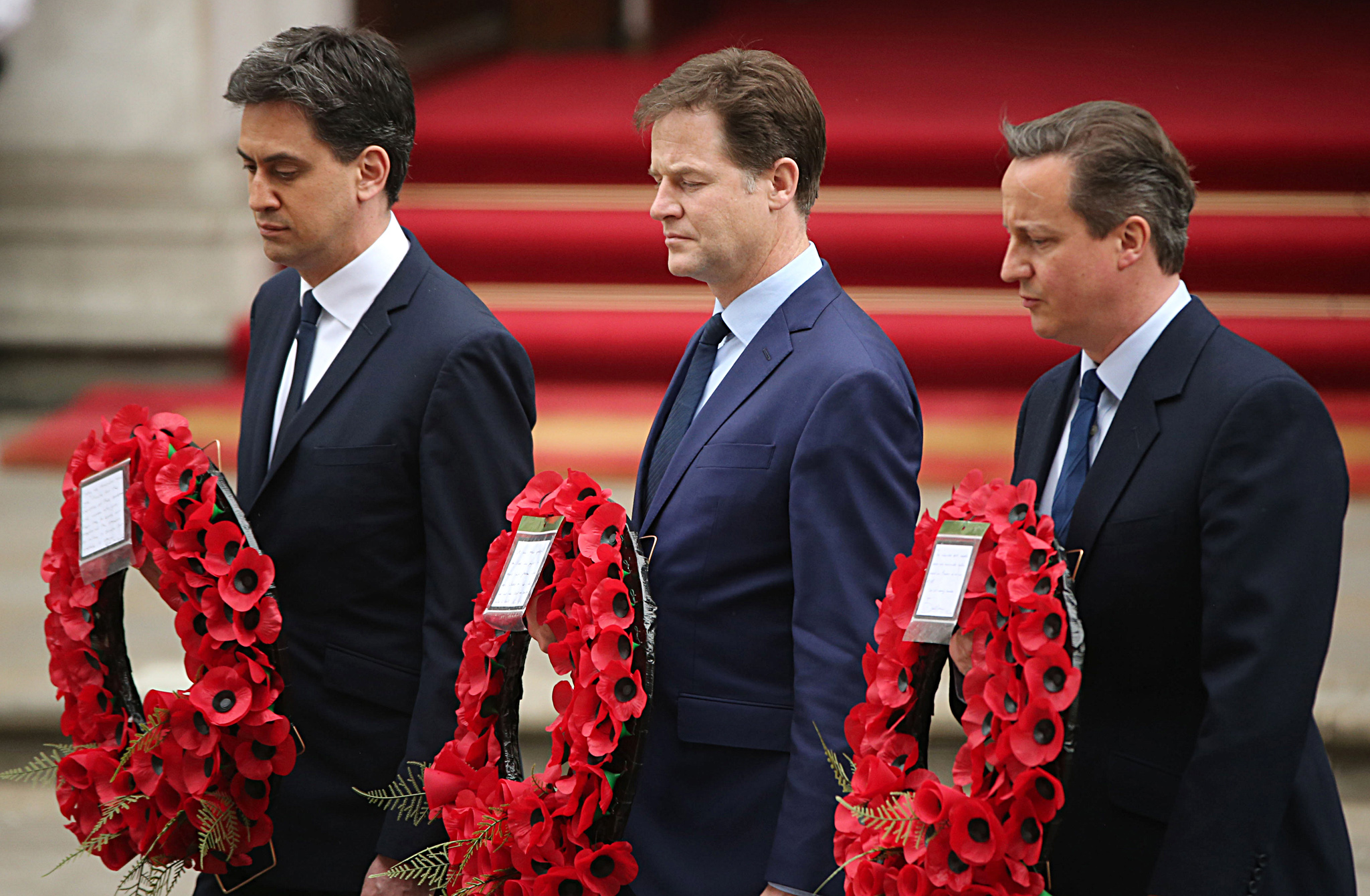 VE Day 70th Anniversary Day One...LONDON, ENGLAND - MAY 08:  (L-R) Labour Party leader Ed Miliband, Liberal Democrat leader Nick Clegg and Prime Minister David Cameron prepare to place a wreath during a tribute at the Cenotaph to begin three days of national commemorations to mark the 70th anniversary of VE Day on May 8, 2015 in London, England. Leaders of the United Kingdom are gathering together after the country went to the polls yesterday and voted to keep Conservative party leader David Cameron as Prime Minister. Great Britain now starts three days of national commemorations of street parties, concerts and other events across the country to remember the end of World War II in Europe.  (Photo by Christopher Furlong/Getty Images)