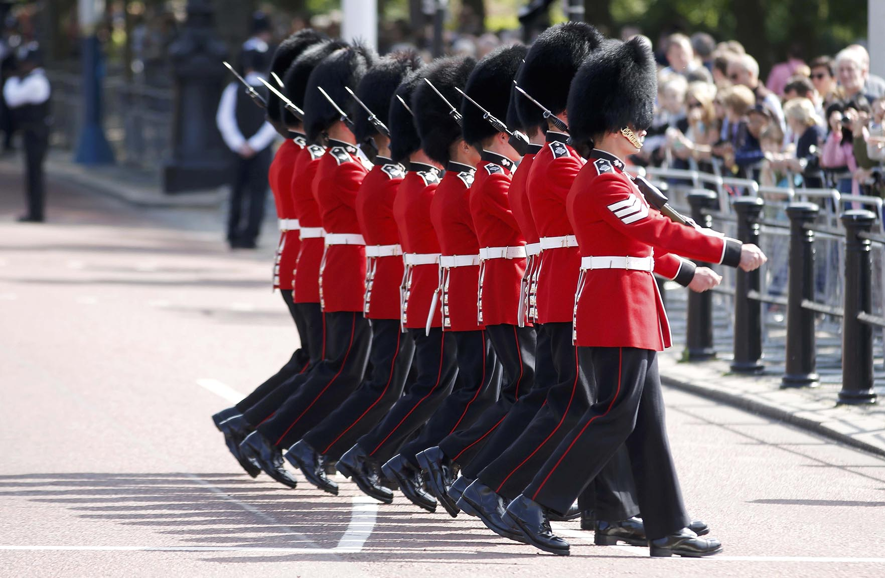 Guardsmen march past Buckingham Palace during the State Opening of Parliament in central Londo