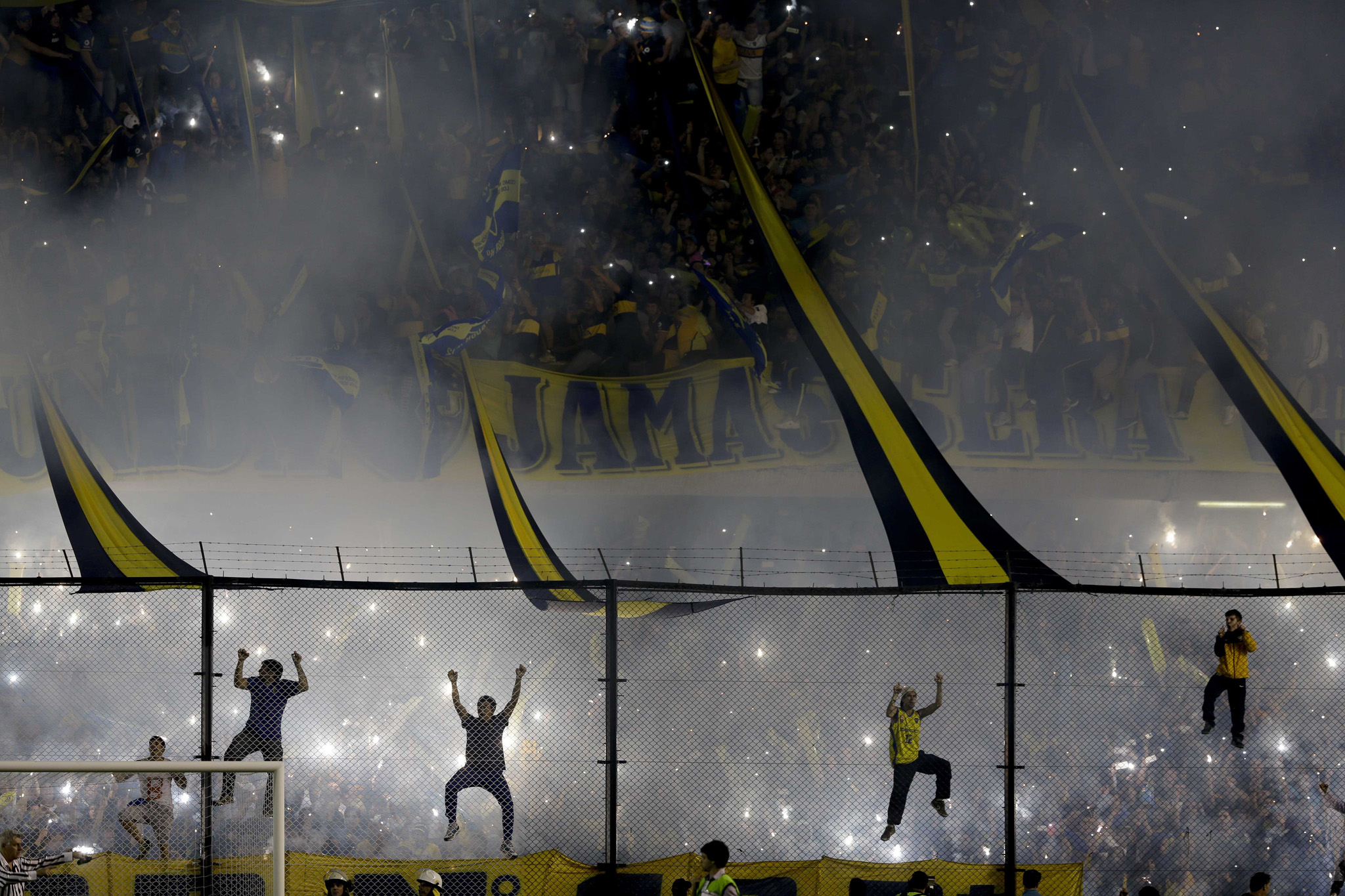 Boca Juniors fans cheer their team before a Copa Libertadores round of sixteen soccer match against River Plate in Buenos Aires, Argentina