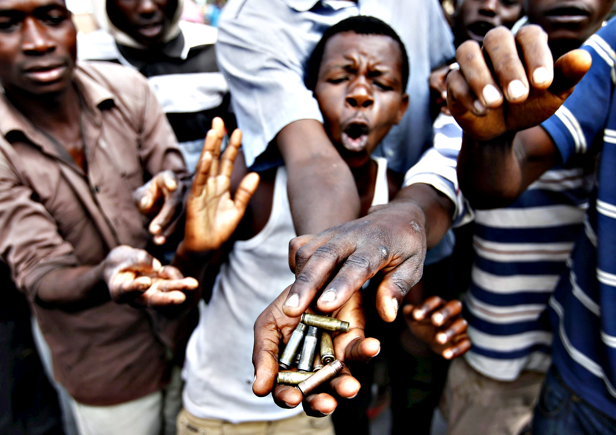 Protesters show bullet casings during a protest against Burundi President Pierre Nkurunziza and his bid for a third term in Bujumbura, Burundi on Tuesday
