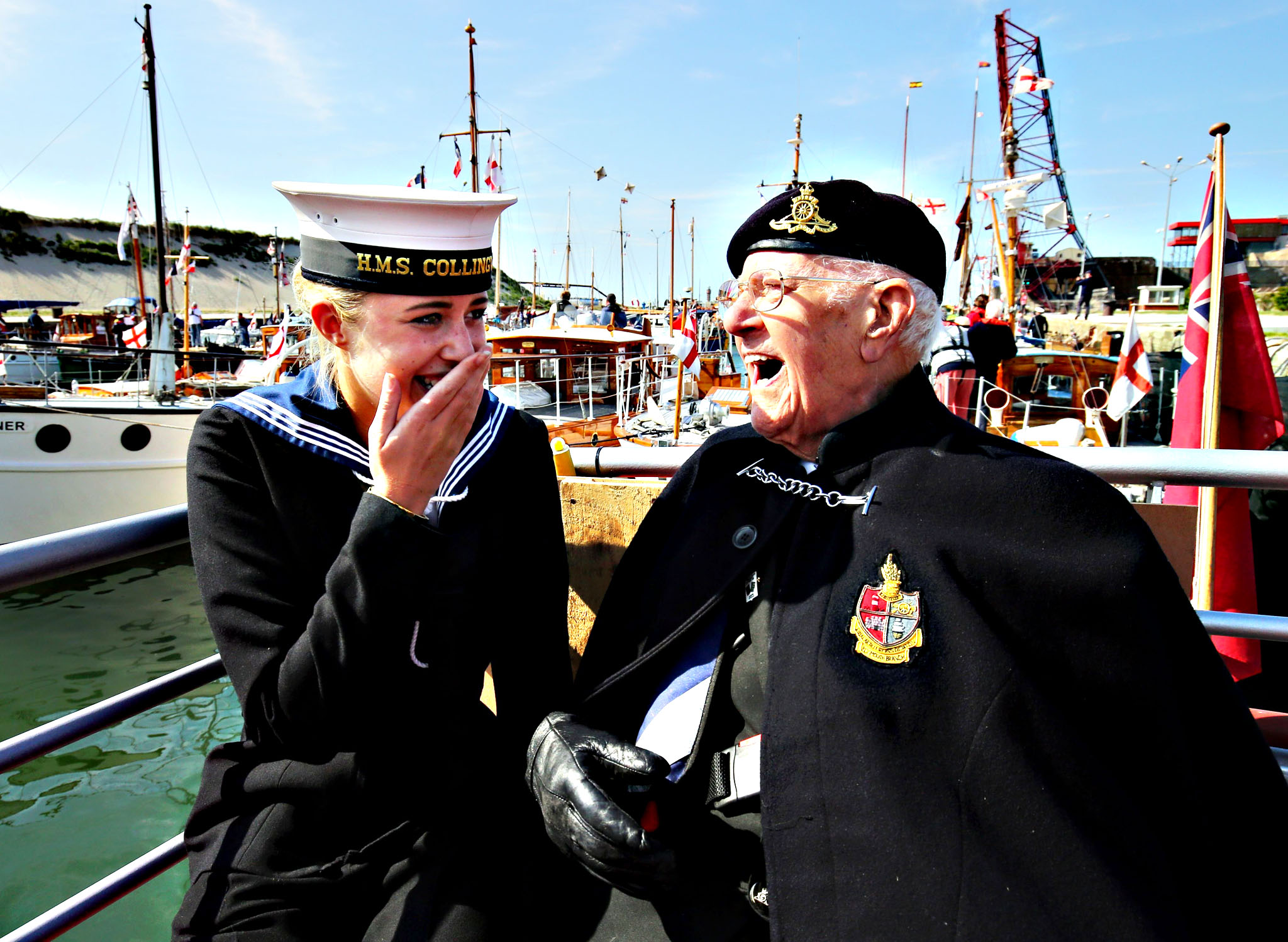 Dunkirk veteran Garth Wright (95) with Royal Navy Wren Lauren Parsons on board the Little Ship the Princess Freda as the Little Ships arrive in Dunkirk, France, to mark the 75th anniversary of Operation Dynamo. PRESS ASSOCIATION Photo. Picture date: Thursday May 21, 2015. Hundreds of fishing boats, pleasure yachts and lifeboats crossed the Channel between May 26 and June 4 1940, to help evacuate Allied forces from the beaches of northern France