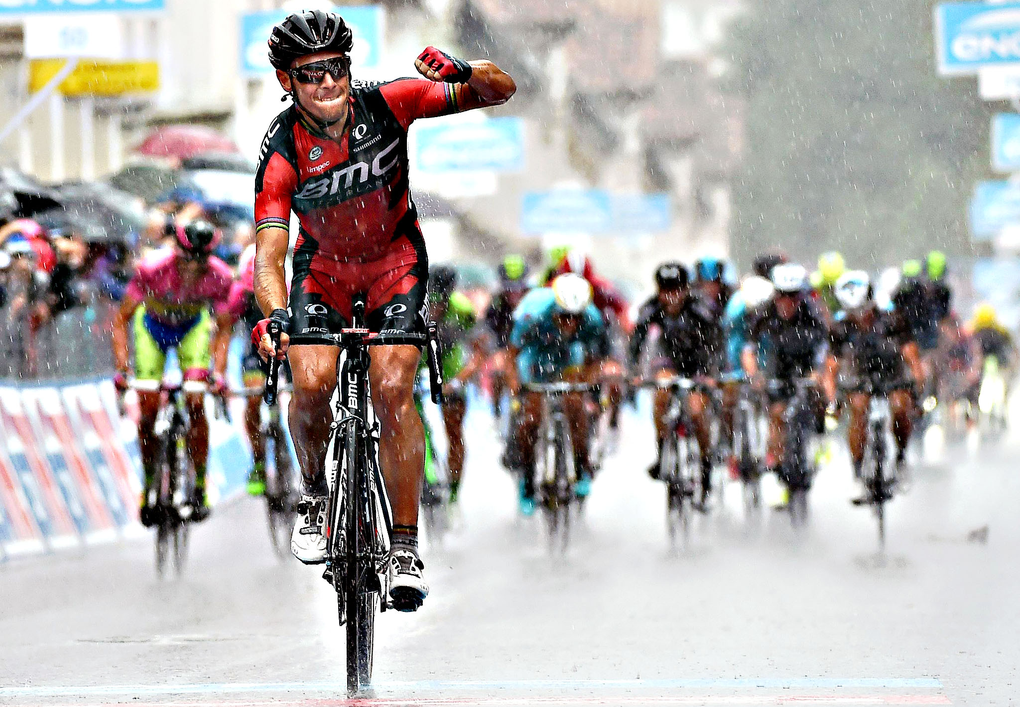 Belgium's Philippe Gilbert celebrates as he crosses the finish line to win the 12th stage of the Giro d'Italia, Tour of Italy cycling race from Imola to Vicenza, Italy, Thursday, May 21, 2015. Alberto Contador extended his overall lead ahead of Fabio Aru to 17 seconds while Philippe Gilbert won the rainy 12th stage of the Giro d'Italia on Thursday