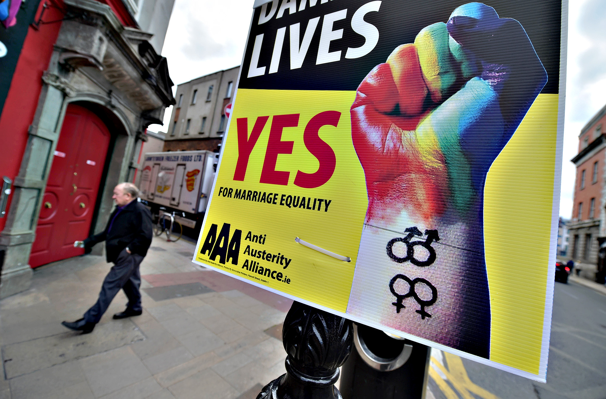 A man walks past billboard posters promoting the Yes campaign in favour of same-sex marriage on Friday in Dublin, Ireland. Voters in the Republic of Ireland are taking part in a referendum on legalising same-sex marriage on Friday. The referendum is being held 22 years after Ireland decriminalised homosexuality with more than 3.2m people being asked whether they want to amend the country's constitution to allow gay and lesbian couples to marry. Polling stations opened at 07:00 BST with voting continuing until 22:00 BST and counting due to start on Saturday morning
