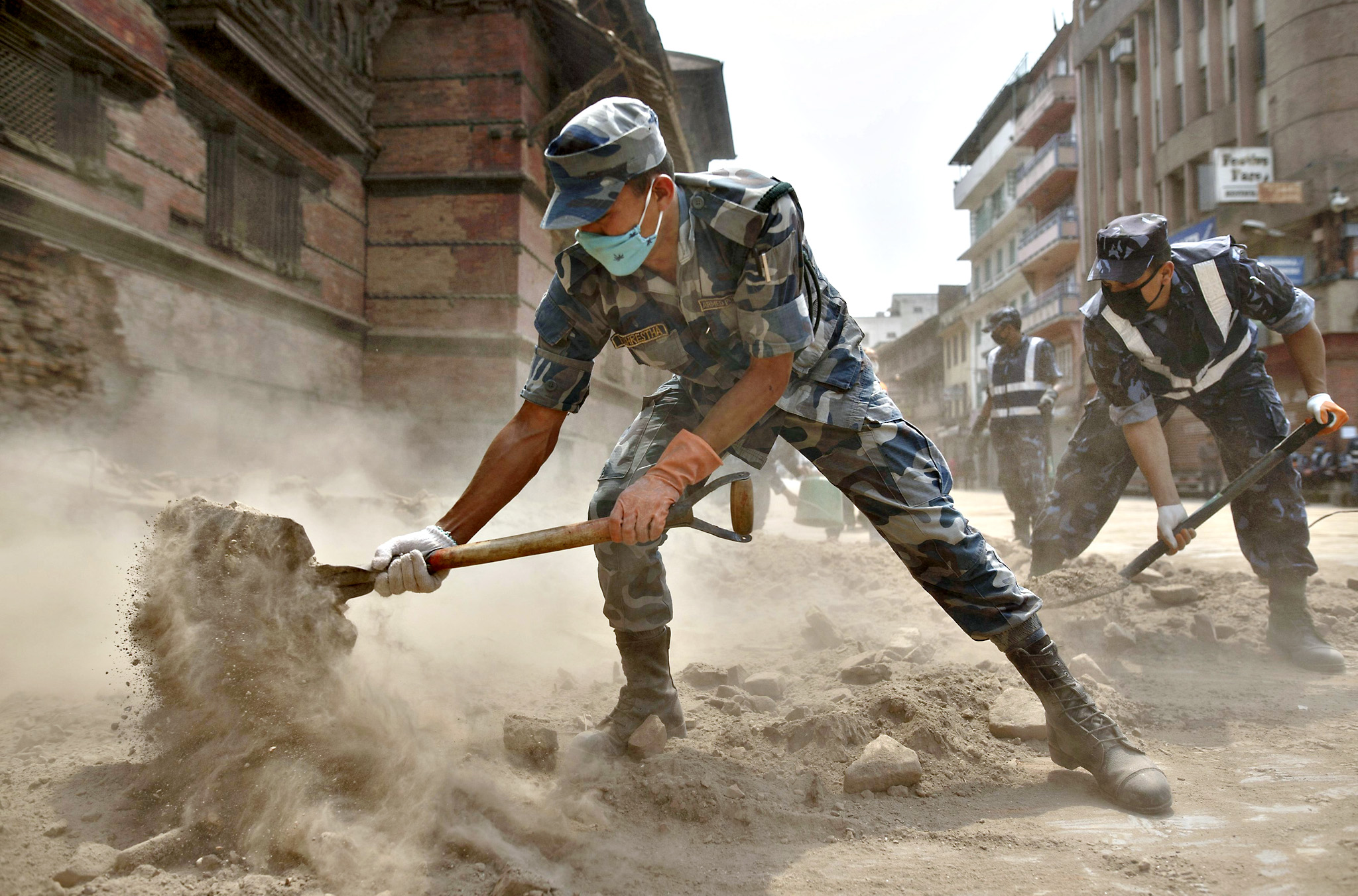 Nepal military personnel work to clear rubble along the street of Bashantapur Durbar Square, a UNESCO world heritage site, after the April 25 earthquake at Kathmandu in Nepal, May 7, 2015.