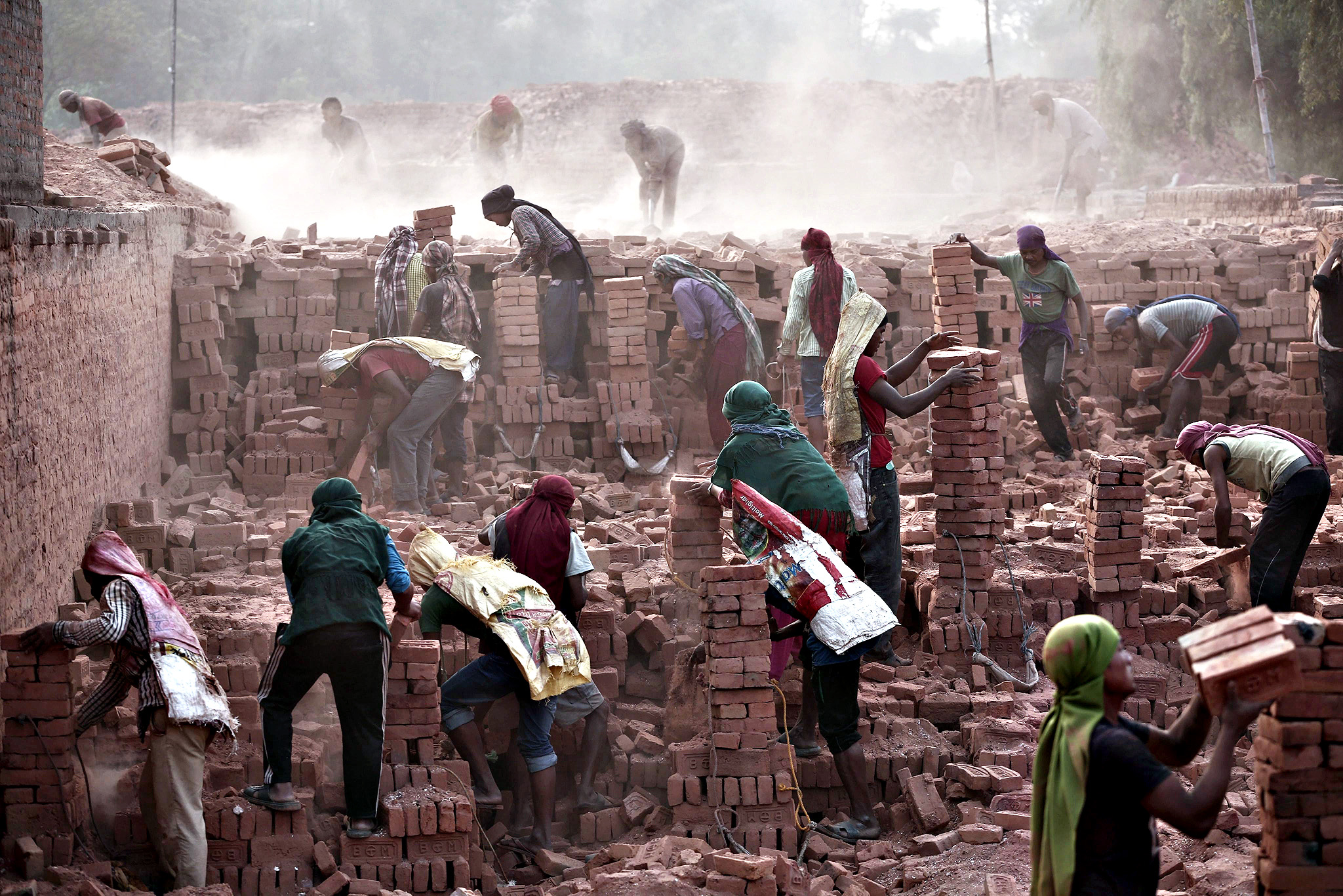 Nepalese laborers work at a brick factory in Bhaktapur, Nepal on Tuesday. Nepal is facing an acute brick crisis after some 40 million houses were damaged and 80 percent of brick kilns were also damaged due to two major earthquakes on 05 April 2015 and 12 May 2015. The official death toll for the 12 May 7.3 magnitude quake rose to 117, authorities said, in addition to the 8,202 victims claimed by the April 25 earthquake.