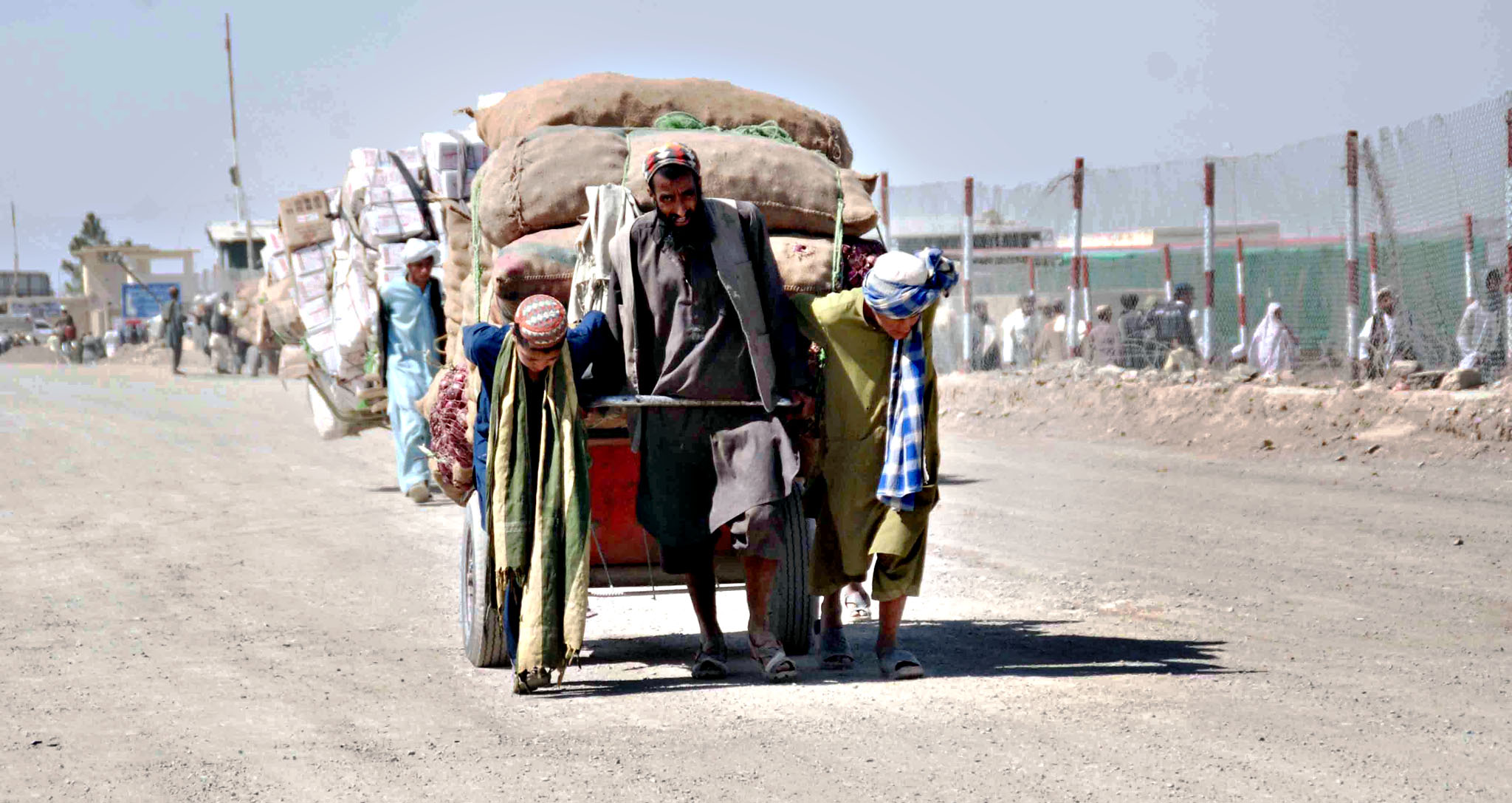 A man and his cart loaded with sacks of vegetables near the Afghan border in Chaman, Pakistan, 22 May 2015. The merchants wait for clearance to cross into Afghanistan with their goods